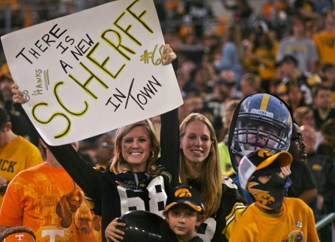 Jan 2, 2015; Jacksonville, FL, USA; Iowa Hawkeyes fans hold up a sign and photo showing their support for offensive lineman Brandon Scherff (not pictured) in the fourth quarter of the 2015 TaxSlayer Bowl at EverBank Field. The Tennessee Volunteers beat the Iowa Hawkeyes 45-28. Mandatory Credit: Phil Sears-USA TODAY Sports