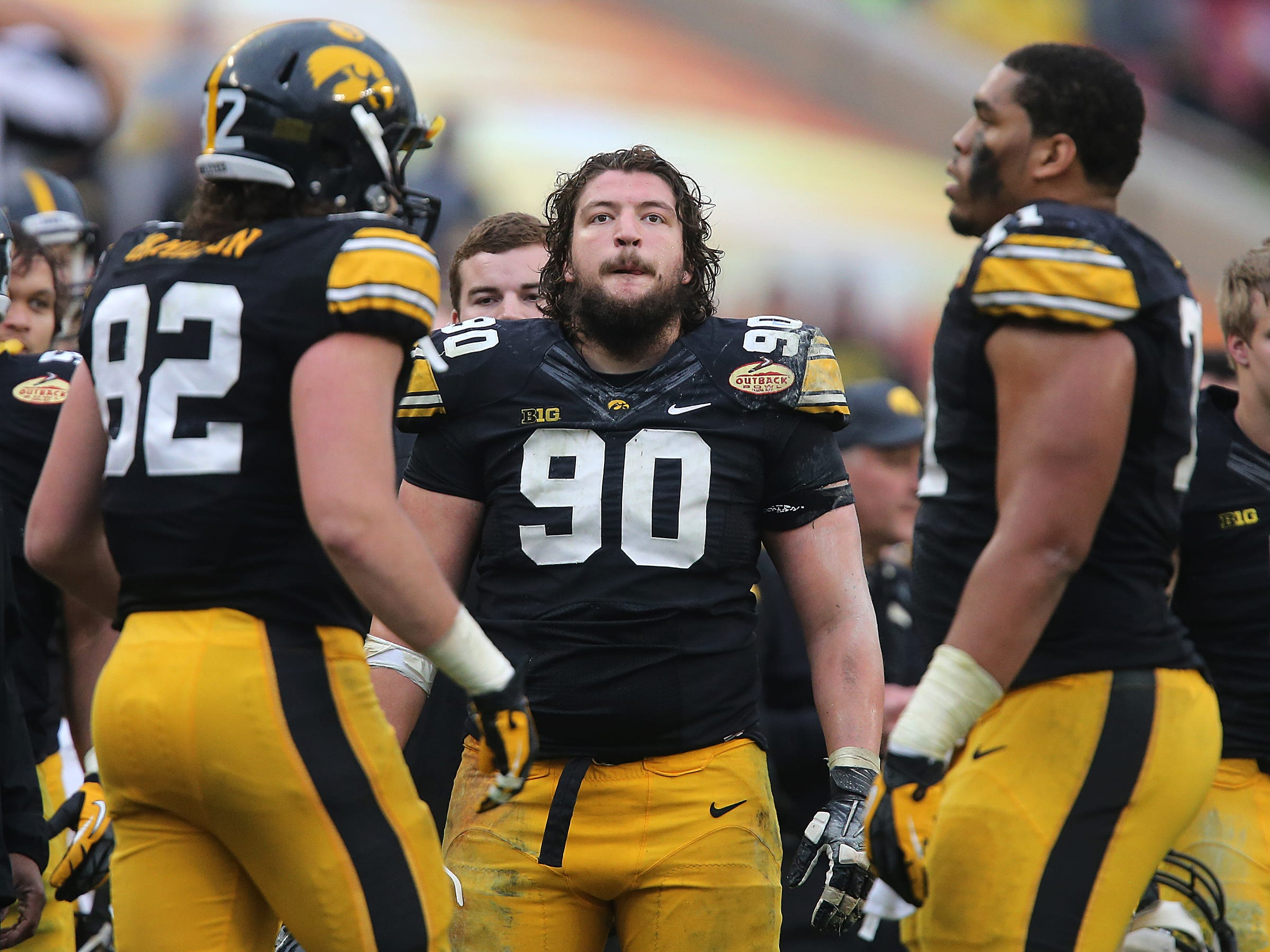Iowa defensive lineman Louis Trinca-Pasat looks up at a replay in the final minute against LSU on Wednesday, Jan. 1, 2014, in Tampa, Florida. (Bryon Houlgrave/The Register)