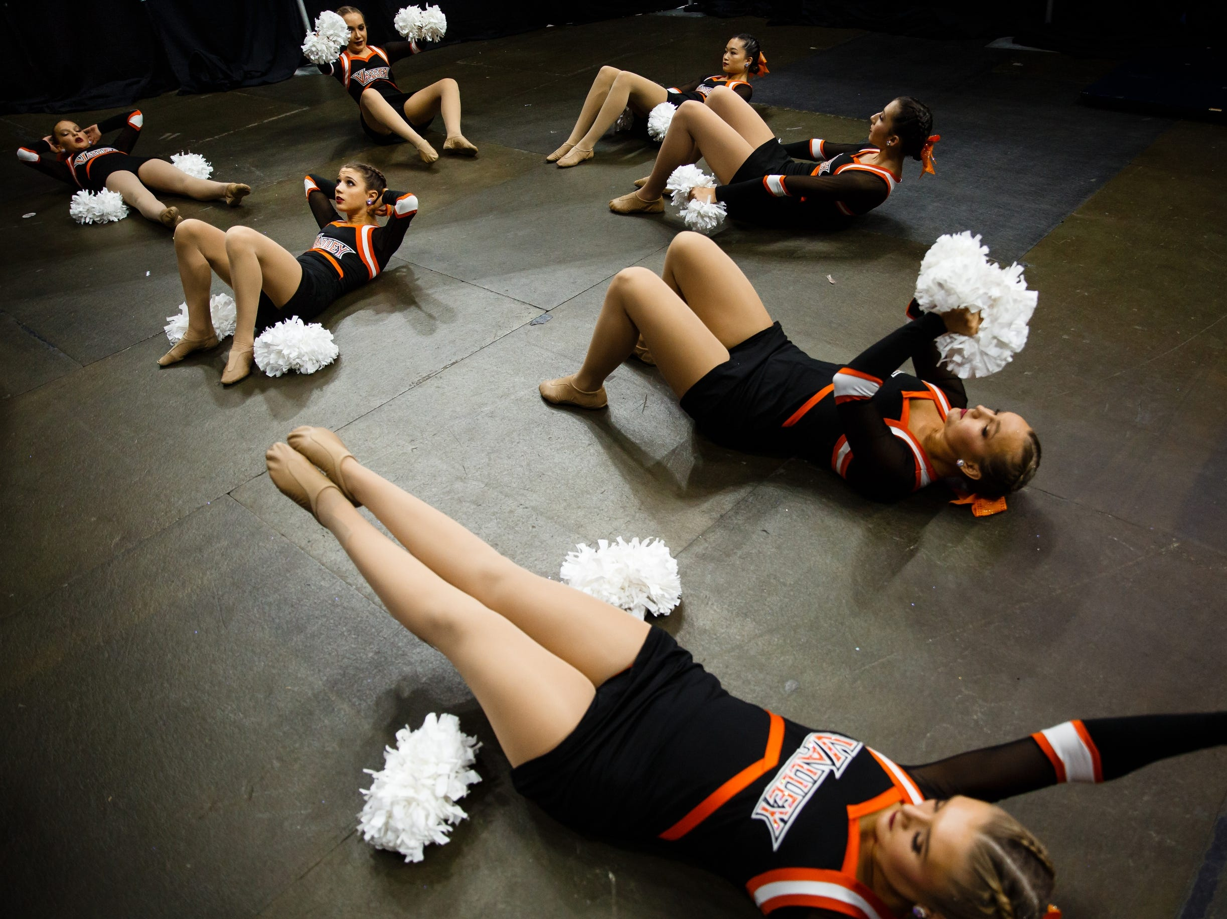 Cheerleaders from Valley High School warm up before performing at the Iowa Dance State Championships at Wells Fargo Arena on Friday, Nov. 30, 2018, in Des Moines.