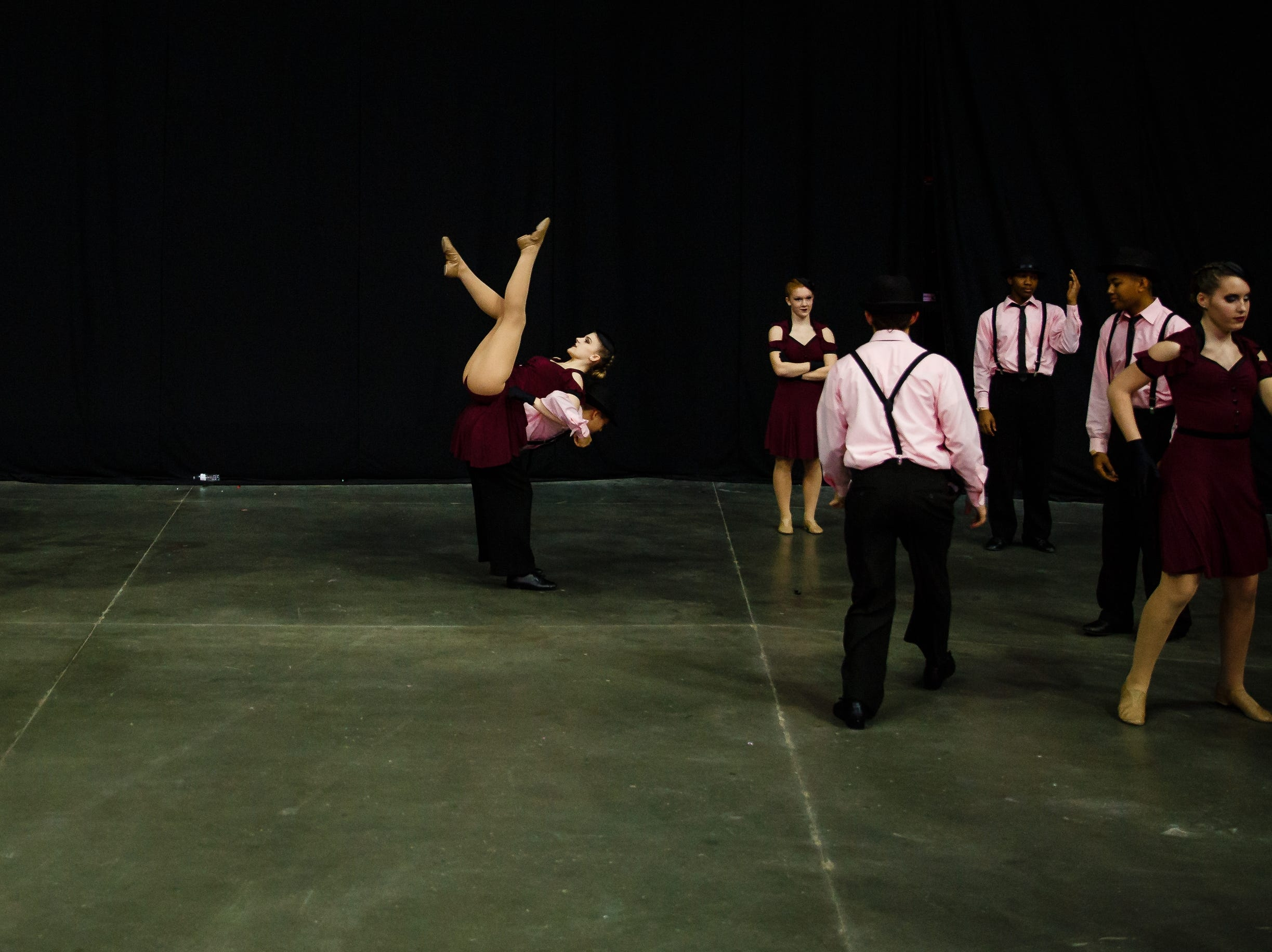 Students from Davenport Central warm up before the Iowa Dance State Championships at Wells Fargo Arena on Friday, Nov. 30, 2018, in Des Moines.