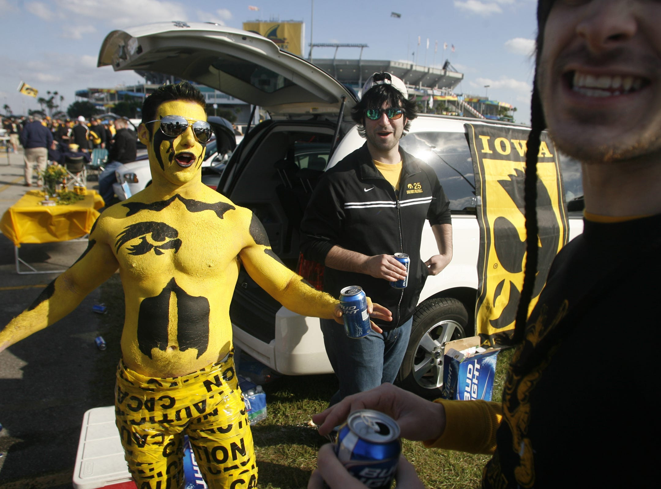 UI senior Ryan McCabe, of Downers Grove, Ill, dons caution tape shorts while tailgating before the start of the Orange Bowl, Tuesday, Jan. 5, 2010, at LandShark Stadium, in Miami Gardens, Fl.