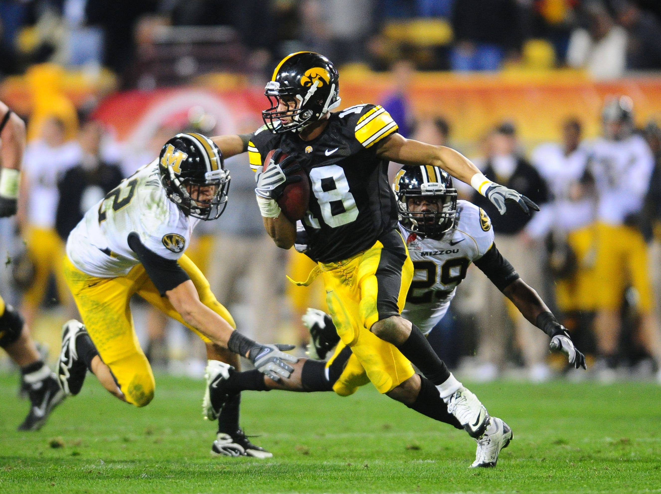Dec. 28, 2010; Tempe, AZ, USA; Iowa Hawkeyes defensive back (18) Micah Hyde returns an interception for a touchdown in the fourth quarter against the Missouri Tigers in the 2010 Insight Bowl at Sun Devil Stadium. Iowa defeated Missouri 27-24. Mandatory Credit: Mark J. Rebilas-USA TODAY Sports