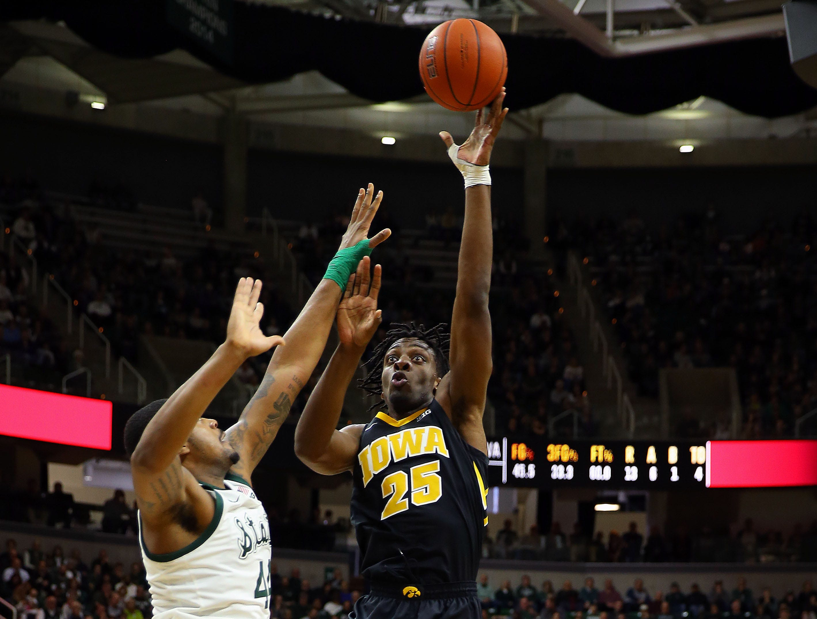 Dec 3, 2018; East Lansing, MI, USA; Iowa Hawkeyes forward Tyler Cook (25) shoots over Michigan State Spartans forward Nick Ward (44) during the first half of a game at Breslin Center. Mandatory Credit: Mike Carter-USA TODAY Sports