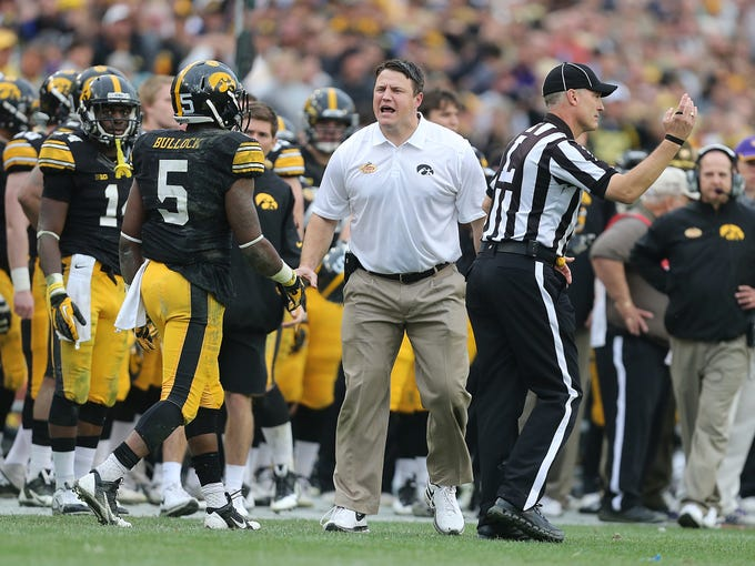 Iowa offensive line coach Brian Ferentz tries to generate a pass interference call after receiver Damon Bullock was hit by LSU's Craig Loston on Wednesday, Jan. 1, 2014, in Tampa, Florida. (Bryon Houlgrave/The Register)