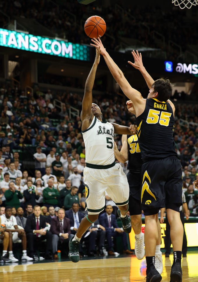 Dec 3, 2018; East Lansing, MI, USA; Michigan State Spartans guard Cassius Winston (5) has his shot blocked by Iowa Hawkeyes forward Luka Garza (55) during the second half of a game at Breslin Center. Mandatory Credit: Mike Carter-USA TODAY Sports