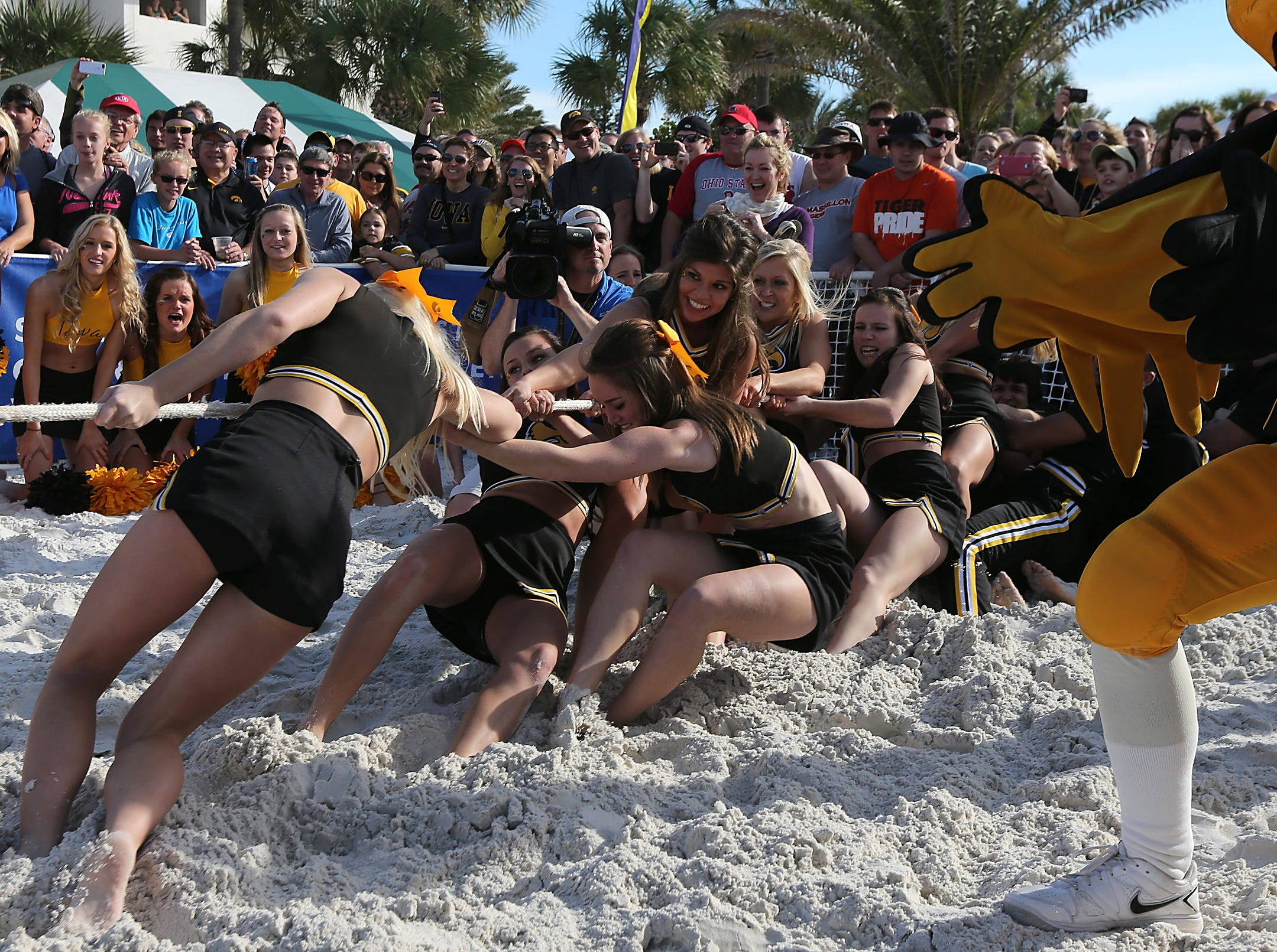 The Iowa Hawkeyes cheerleading squad defeated the LSU cheerleading team in three rounds of tug-of-war on Monday, Dec. 30, 2013, in Clearwater, Florida. (Bryon Houlgrave/The Register)