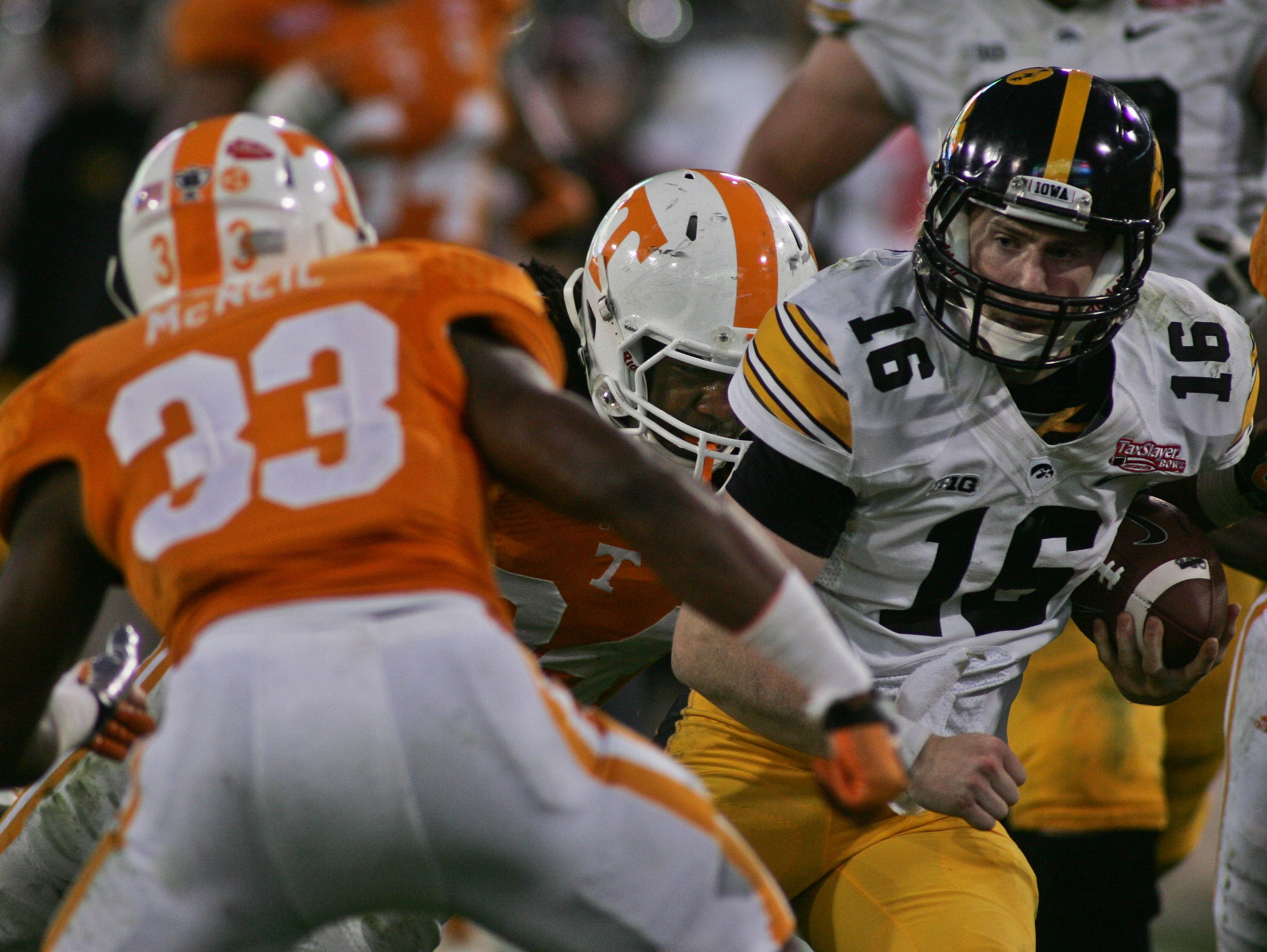 Jan 2, 2015; Jacksonville, FL, USA; Iowa Hawkeyes quarterback C.J. Beathard (16) runs for a first down as he tries to elude Tennessee Volunteers defensive back LaDarrell McNeil (33) in the third quarter of the 2015 TaxSlayer Bowl at EverBank Field. The Tennessee Volunteers beat the Iowa Hawkeyes 45-28. Mandatory Credit: Phil Sears-USA TODAY Sports
