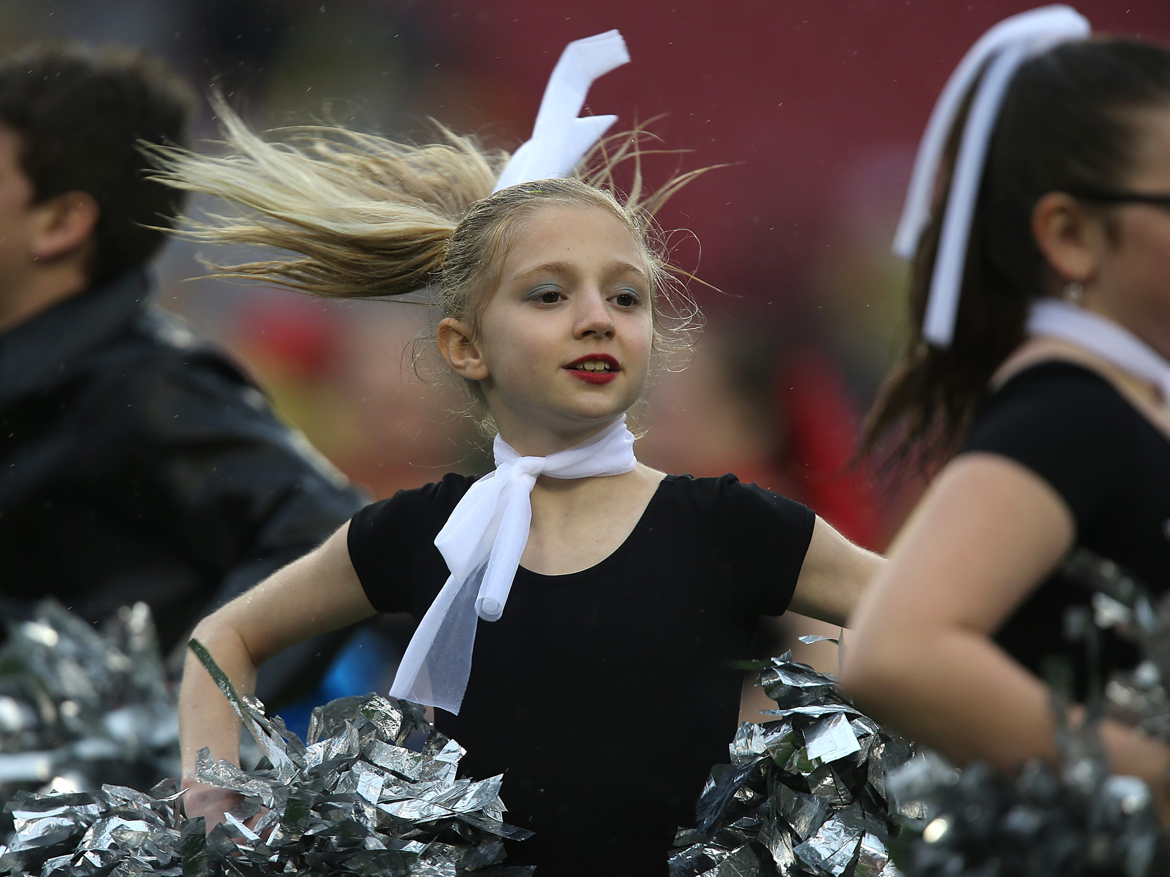 Amanda Schuessler, 10, of Osage, performs a dance routine during the pre-game activities of the 2014 Outback Bowl on Wednesday, Jan. 1, 2014, in Tampa, Florida. (Bryon Houlgrave/The Register)