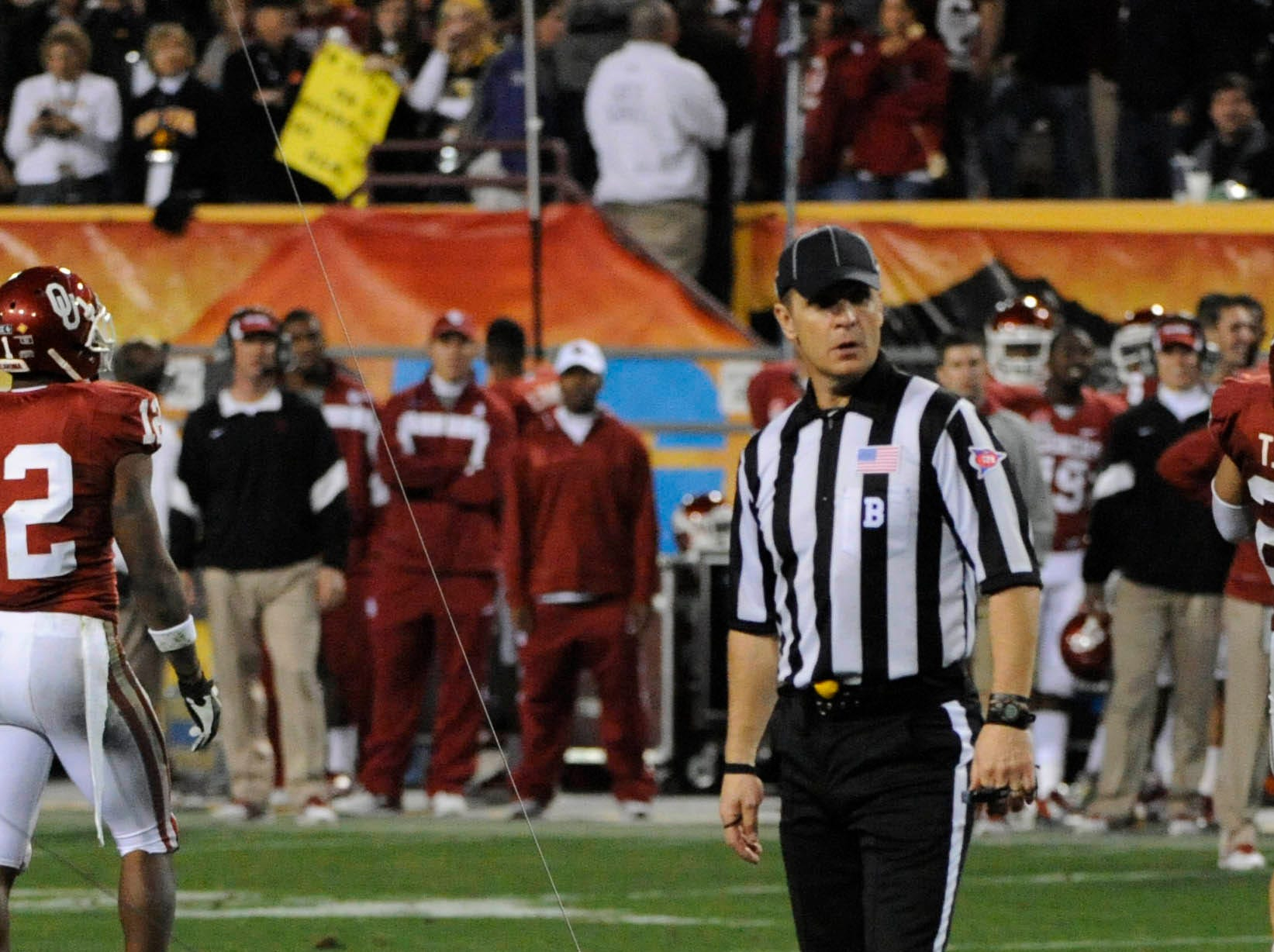 Dec 30, 2011; Tempe, AZ, USA; A referee looks at a fallen skycam during the second half of the 2011 Insight Bowl between Iowa Hawkeyes and Oklahoma Sooners at the Sun Devil Stadium. Mandatory Credit: Richard Mackson-USA TODAY Sports