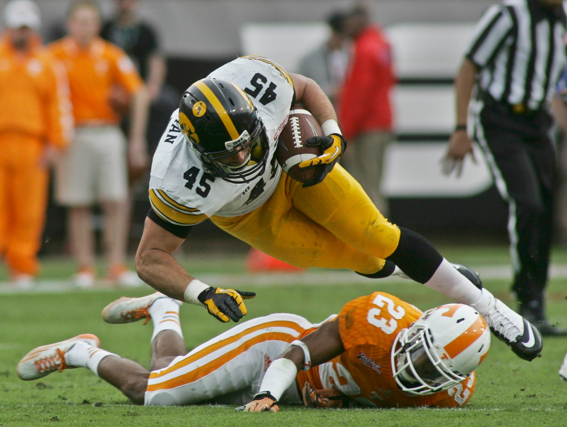 Jan 2, 2015; Jacksonville, FL, USA; Iowa Hawkeyes running back Mark Weisman (45) dives over Tennessee Volunteers defensive back Cameron Sutton (23) in the first quarter of their 2015 TaxSlayer Bowl at EverBank Field. Mandatory Credit: Phil Sears-USA TODAY Sports