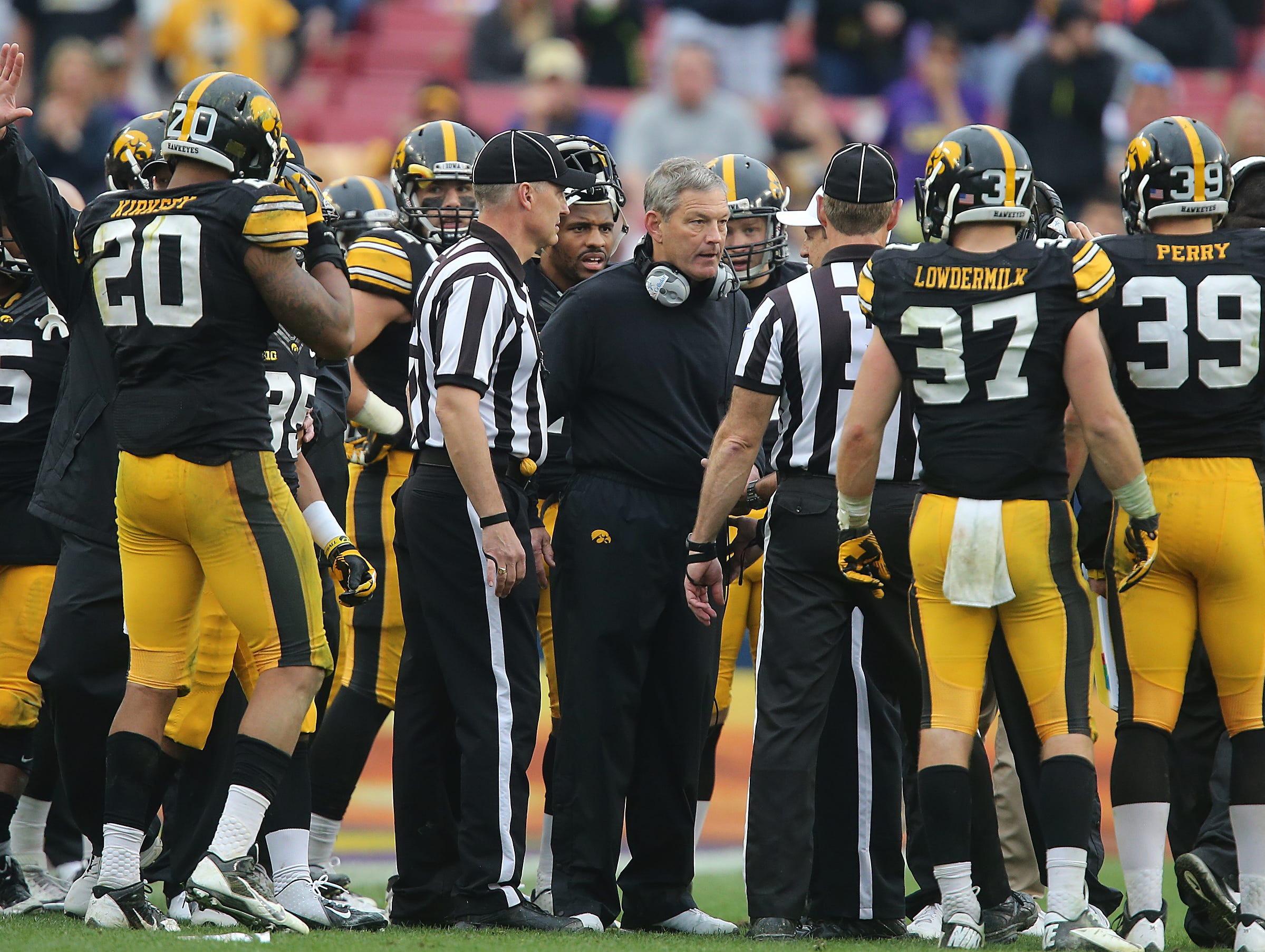 Iowa coach Kirk Ferentz questions an official in the Outback Bowl game against LSU on Wednesday, Jan. 1, 2014, in Tampa, Florida. (Bryon Houlgrave/The Register)
