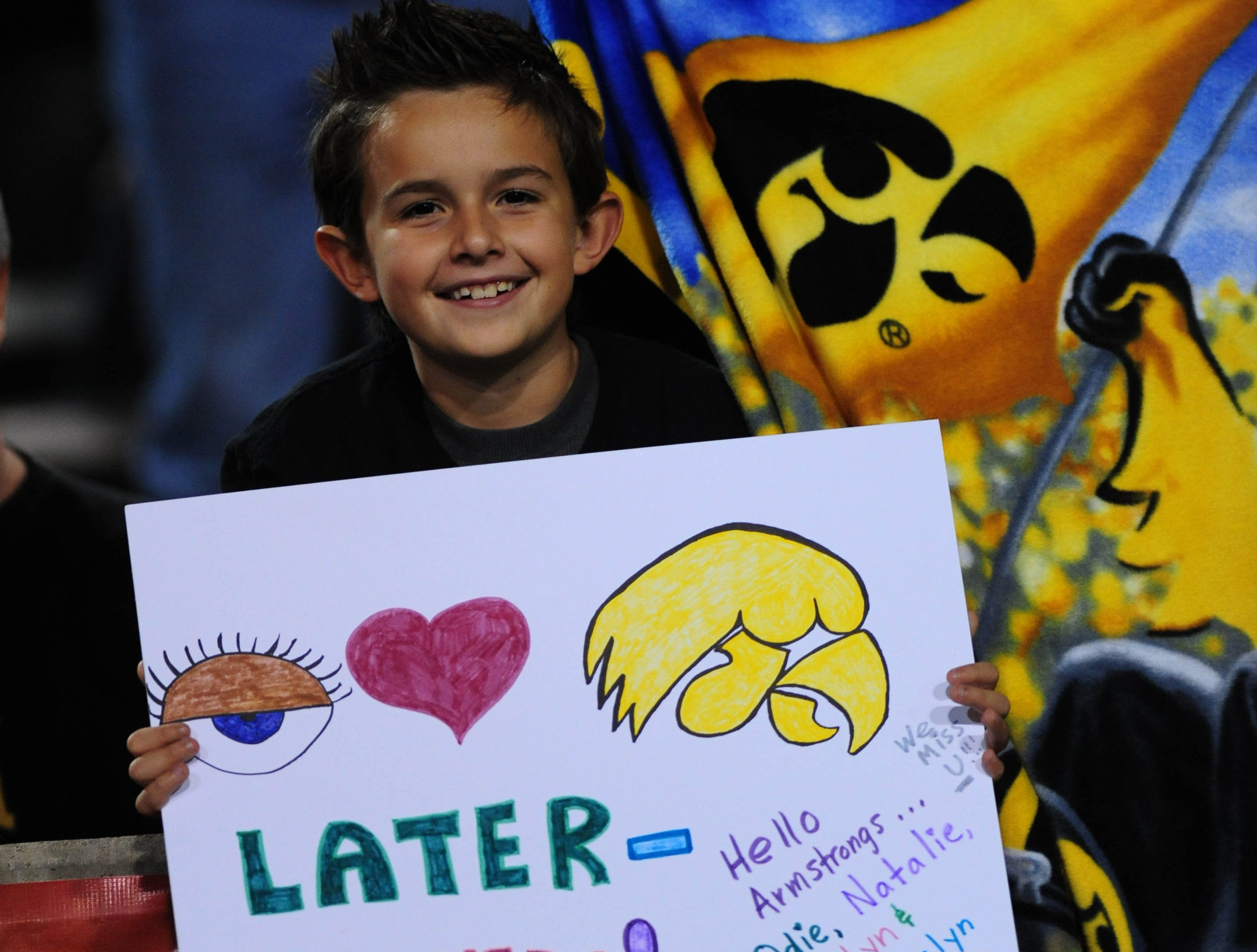 Dec 30, 2011; Tempe, AZ, USA;  A young Iowa Hawkeyes fan holds a sign during the first quarter against Oklahoma Sooners during the 2011 Insight Bowl at the Sun Devil Stadium. Mandatory Credit: Jennifer Hilderbrand-USA TODAY Sports