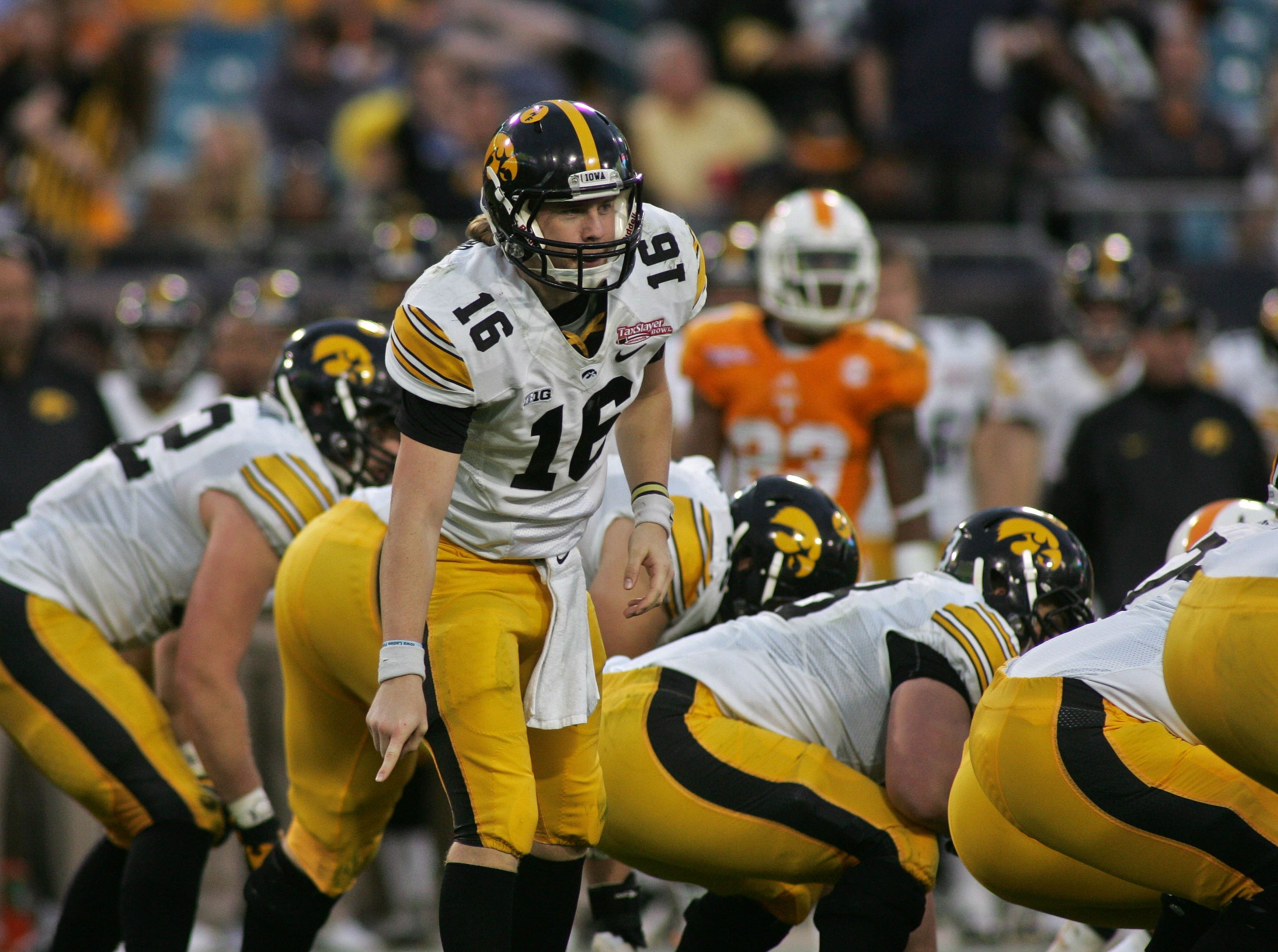 Jan 2, 2015; Jacksonville, FL, USA; Iowa Hawkeyes quarterback C.J. Beathard (16) calls an audible in the third quarter of the 2015 TaxSlayer Bowl against the Tennessee Volunteers at EverBank Field. The Tennessee Volunteers beat the Iowa Hawkeyes 45-28. Mandatory Credit: Phil Sears-USA TODAY Sports