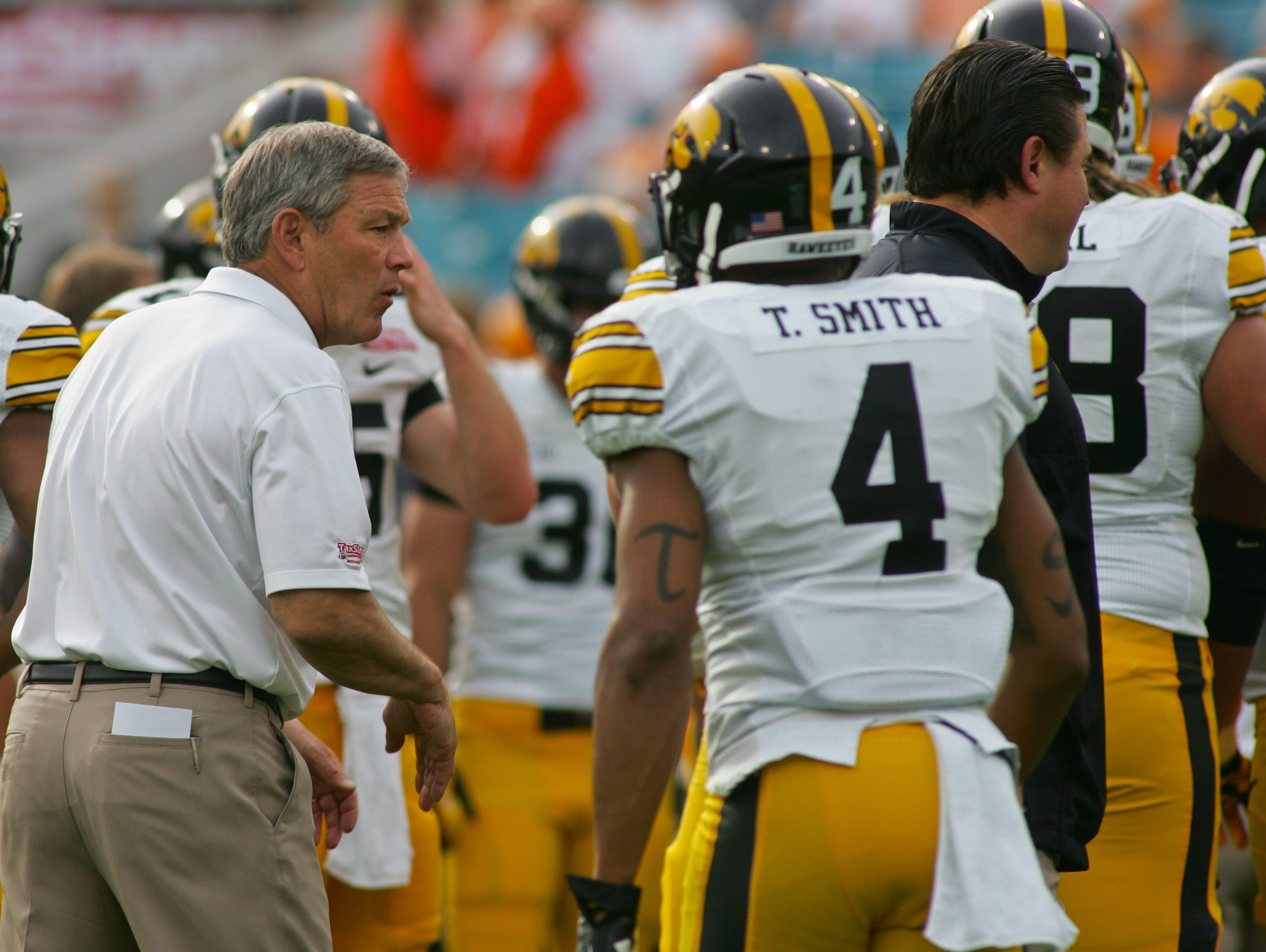 Jan 2, 2015; Jacksonville, FL, USA; Iowa Hawkeyes head coach Kirk Ferentz, left, talks to his team before the start of the 2015 TaxSlayer Bowl against the Tennessee Volunteers at EverBank Field. The Tennessee Volunteers beat the Iowa Hawkeyes 45-28. Mandatory Credit: Phil Sears-USA TODAY Sports