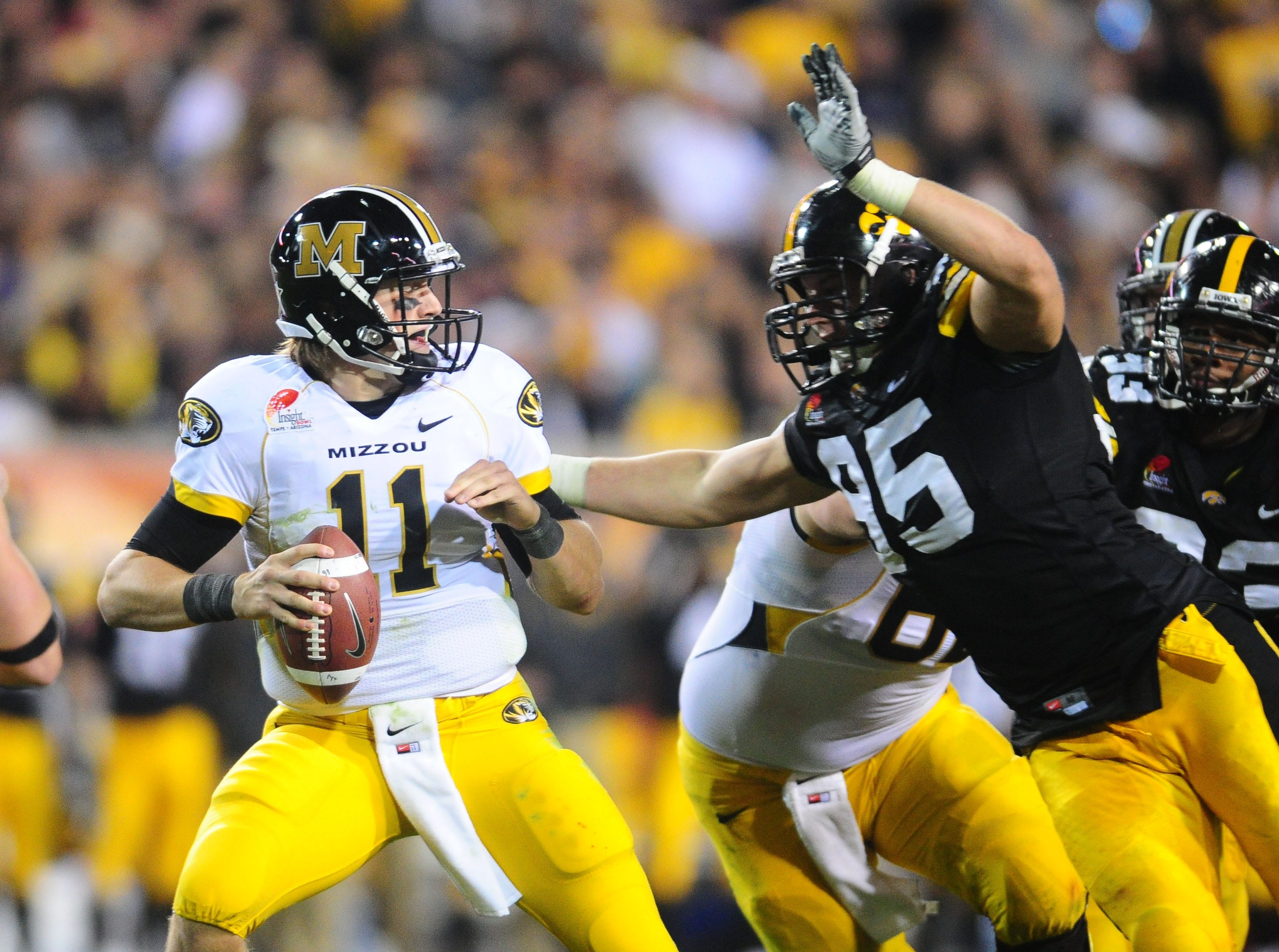 Dec. 28, 2010; Tempe, AZ, USA; Missouri Tigers quarterback (11) Blaine Gabbert is sacked by Iowa Hawkeyes defensive lineman (95) Karl Klug in the second quarter in the 2010 Insight Bowl at Sun Devil Stadium. Mandatory Credit: Mark J. Rebilas-USA TODAY Sports