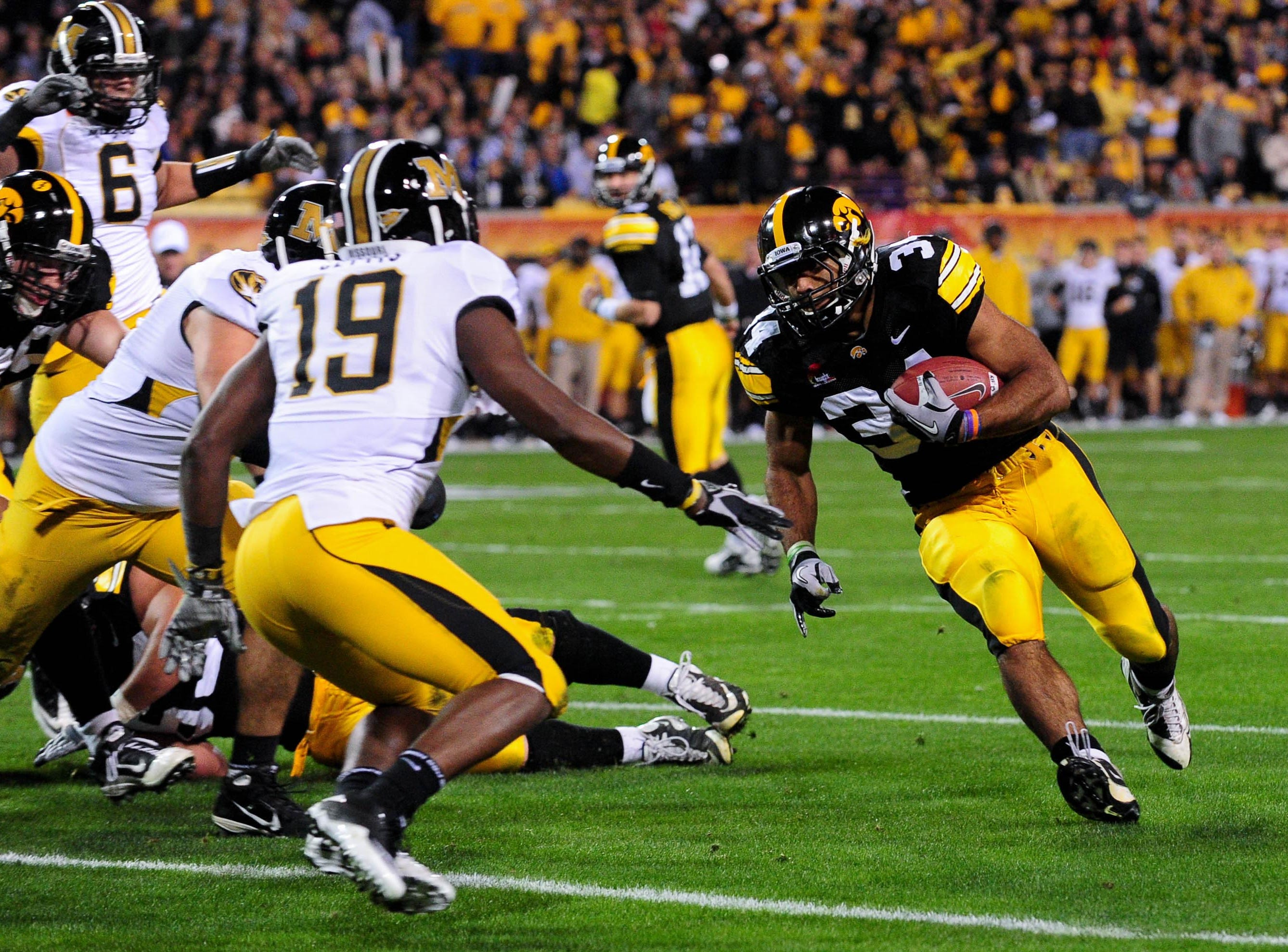 Dec. 28, 2010; Tempe, AZ, USA; Iowa Hawkeyes running back Marcus Coker runs during the second quarter against the Missouri Tigers during the 2010 Insight Bowl at Sun Devil Stadium. Mandatory Credit: Matt Kartozian-USA TODAY Sports