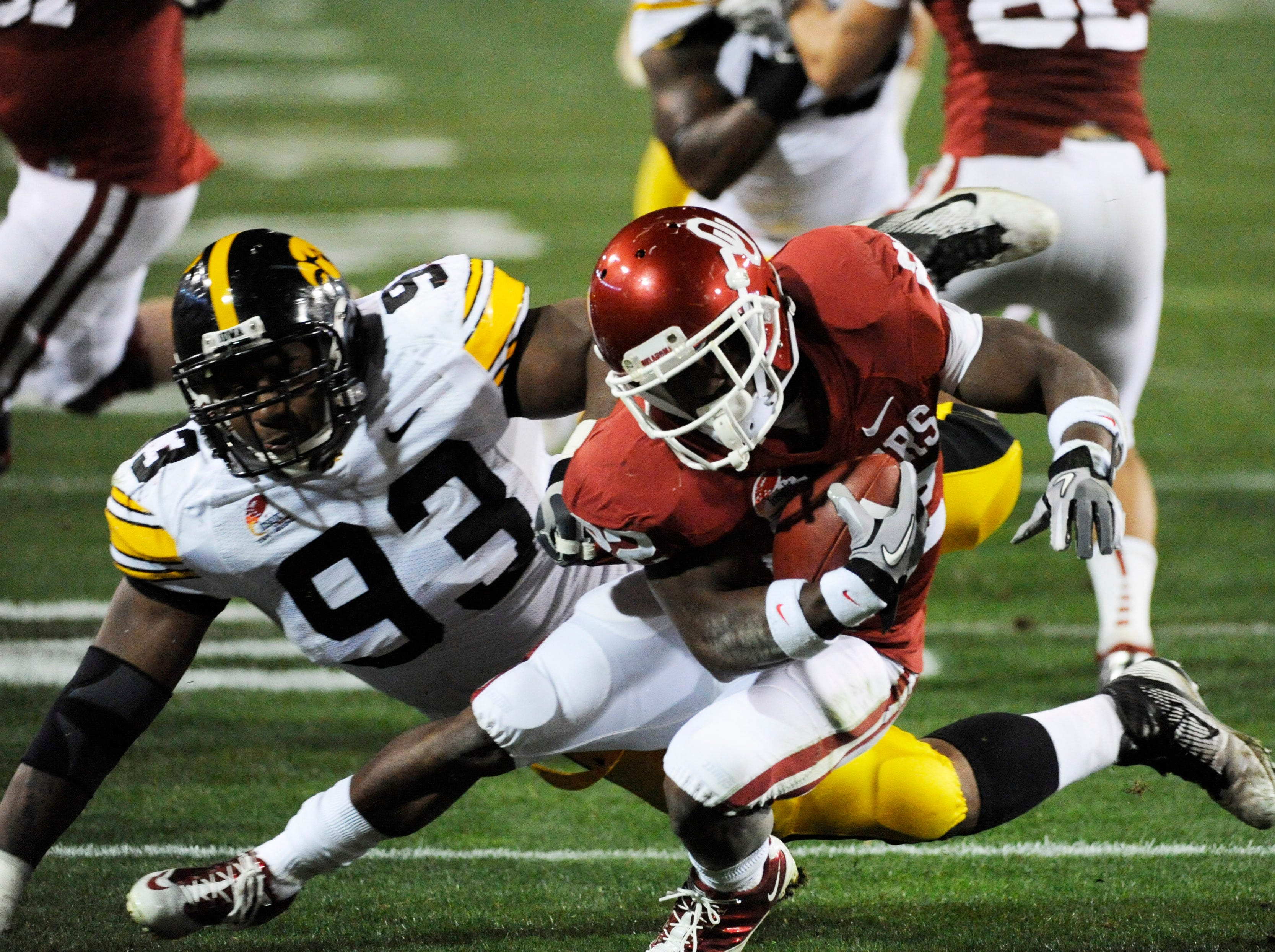Dec 30, 2011; Tempe, AZ, USA; Iowa Hawkeyes defensive lineman Mike Daniels (93) tackles Oklahoma Sooners running back Roy Finch (22) during the first half of the 2011 Insight Bowl at the Sun Devil Stadium. Mandatory Credit: Richard Mackson-USA TODAY Sports