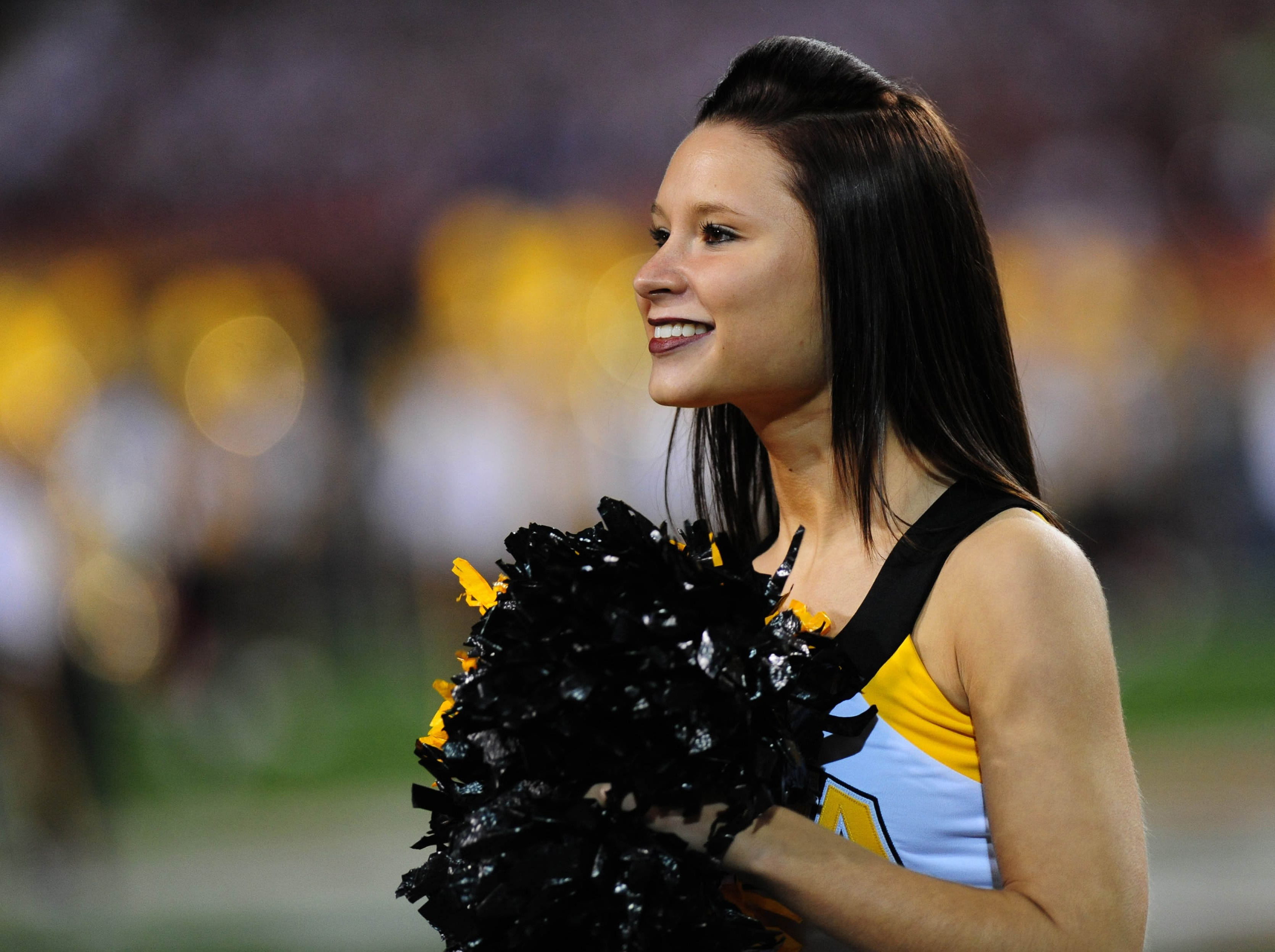 Dec 30, 2011; Tempe, AZ, USA;  Iowa Hawkeyes cheerleader before the game  against Oklahoma Sooners during the 2011 Insight Bowl at the Sun Devil Stadium. Mandatory Credit: Jennifer Hilderbrand-USA TODAY Sports