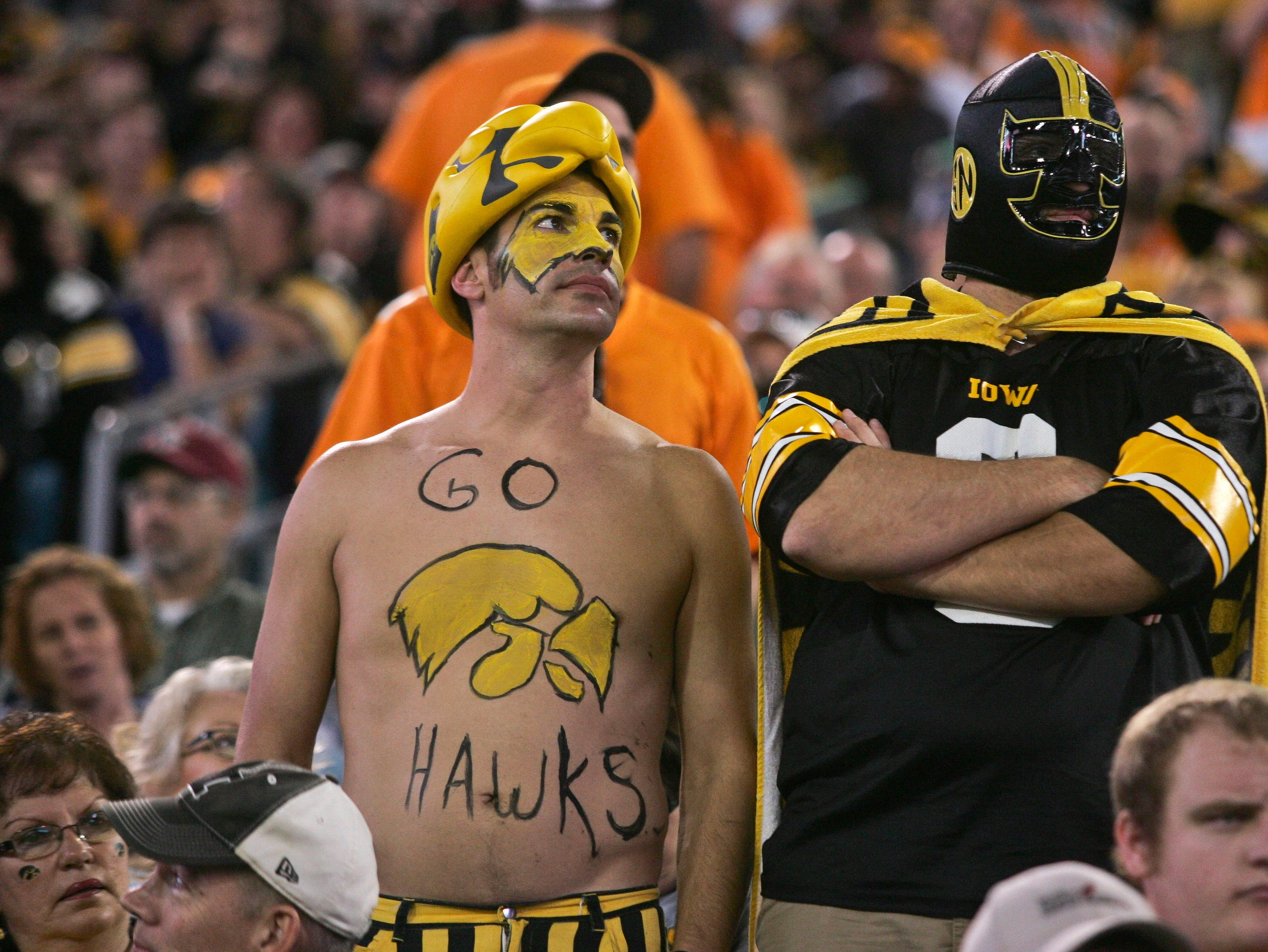 Jan 2, 2015; Jacksonville, FL, USA; Iowa Hawkeyes fans react in the fourth quarter of their 2015 TaxSlayer Bow game against the Tennessee Volunteersl at EverBank Field. The Tennessee Volunteers beat the Iowa Hawkeyes 45-28. Mandatory Credit: Phil Sears-USA TODAY Sports