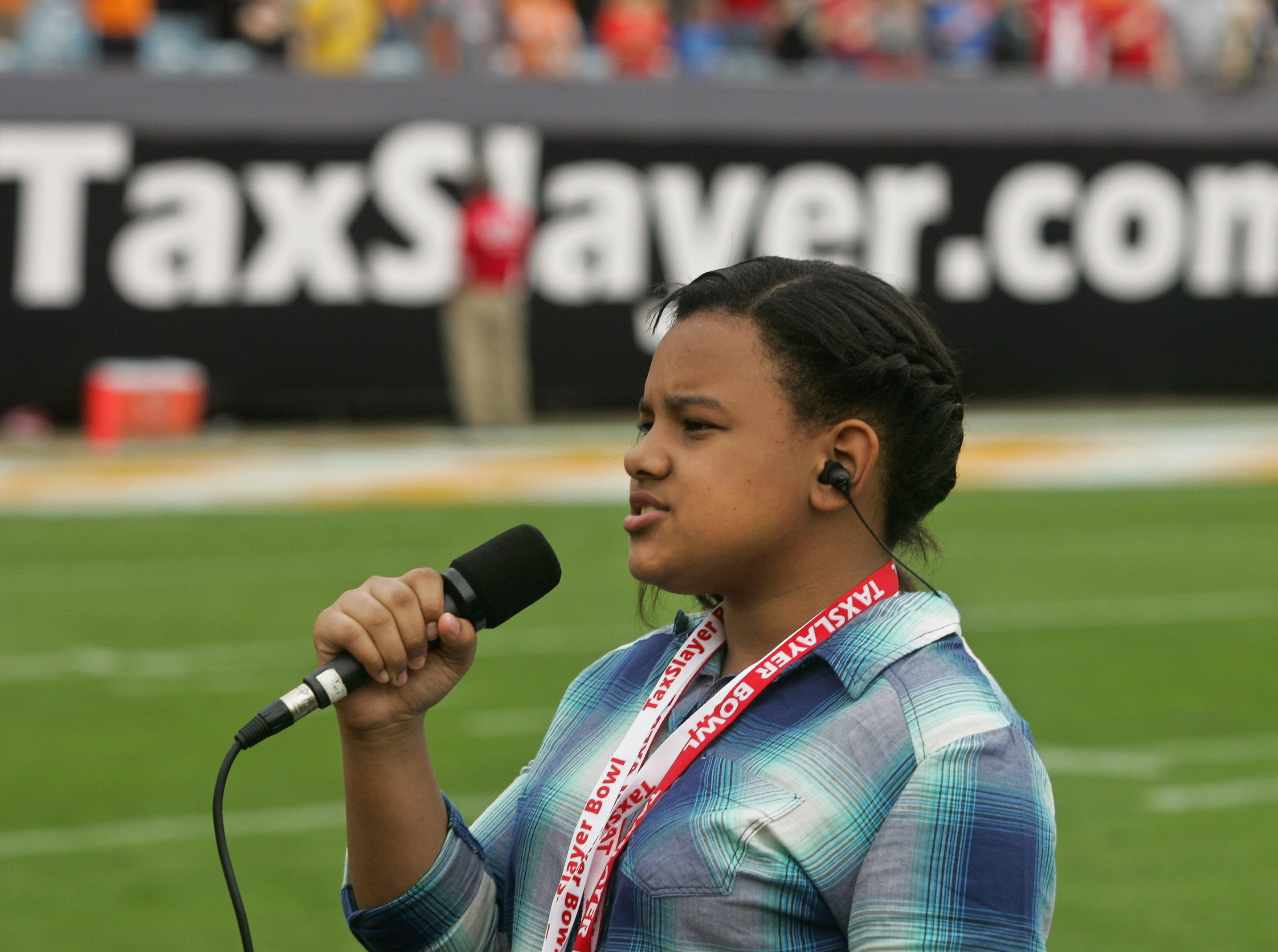 Jan 2, 2015; Jacksonville, FL, USA; Kiyana Williams sings the national anthem before the start of the 2015 TaxSlayer Bowl at EverBank Field. The Tennessee Volunteers beat the Iowa Hawkeyes 45-28. Mandatory Credit: Phil Sears-USA TODAY Sports