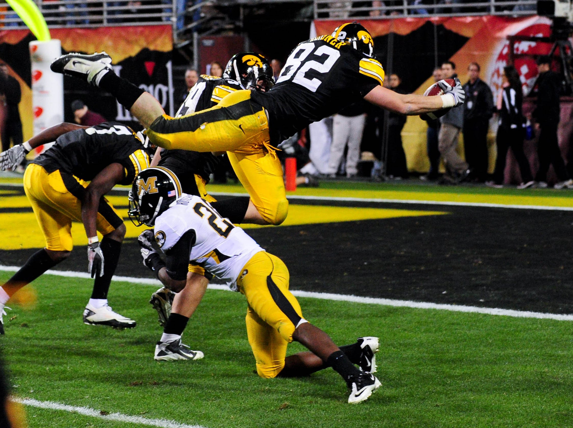 Dec. 28, 2010; Tempe, AZ, USA; Iowa Hawkeyes tight end Allen Reisner (82) dives towards the end zone in the closing seconds of the game against the Missouri Tigers during the 2010 Insight Bowl at Sun Devil Stadium. The Hawkeyes beat the Tigers 27-24.  Mandatory Credit: Matt Kartozian-USA TODAY Sports
