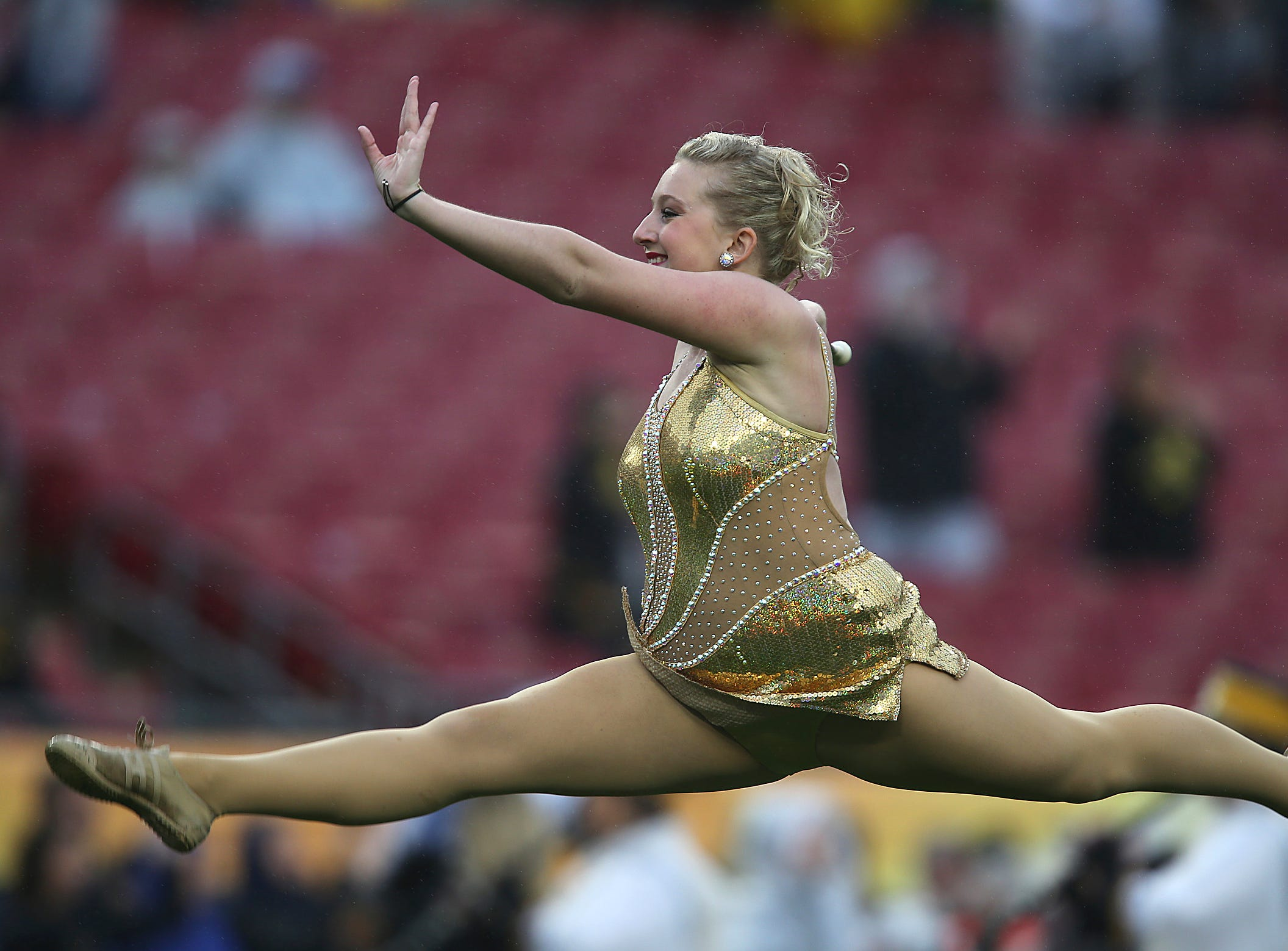 Iowa Golden Girl Whittney Seckar-Anderson, of Oshkosh, Wis., performs a routine during the Iowa Marching Band's pre-game performance prior to kickoff with LSU in the Outback Bowl on Wednesday, Jan. 1, 2014, in Tampa, Florida. (Bryon Houlgrave/The Register)