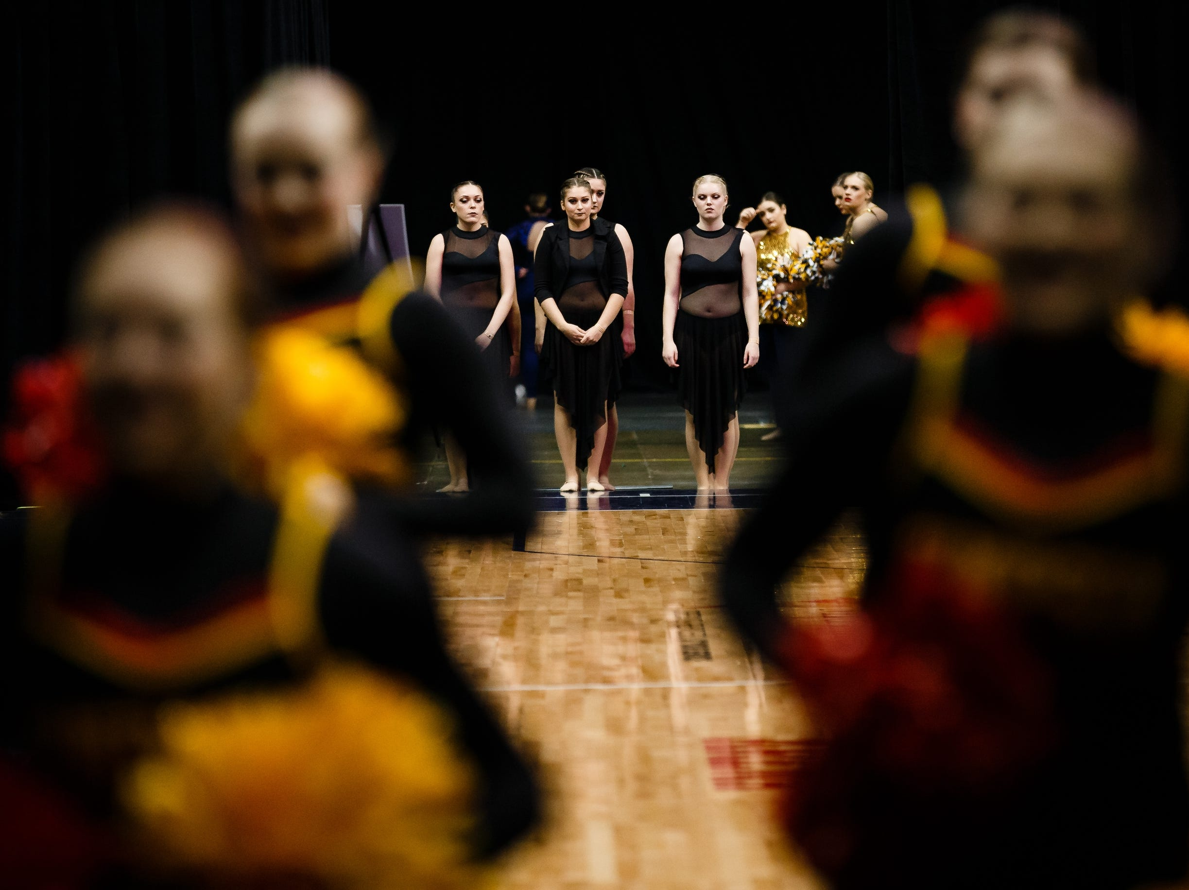 Clarke University dancers wait to be called during the Iowa Dance State Championships at Wells Fargo Arena on Friday, Nov. 30, 2018, in Des Moines.