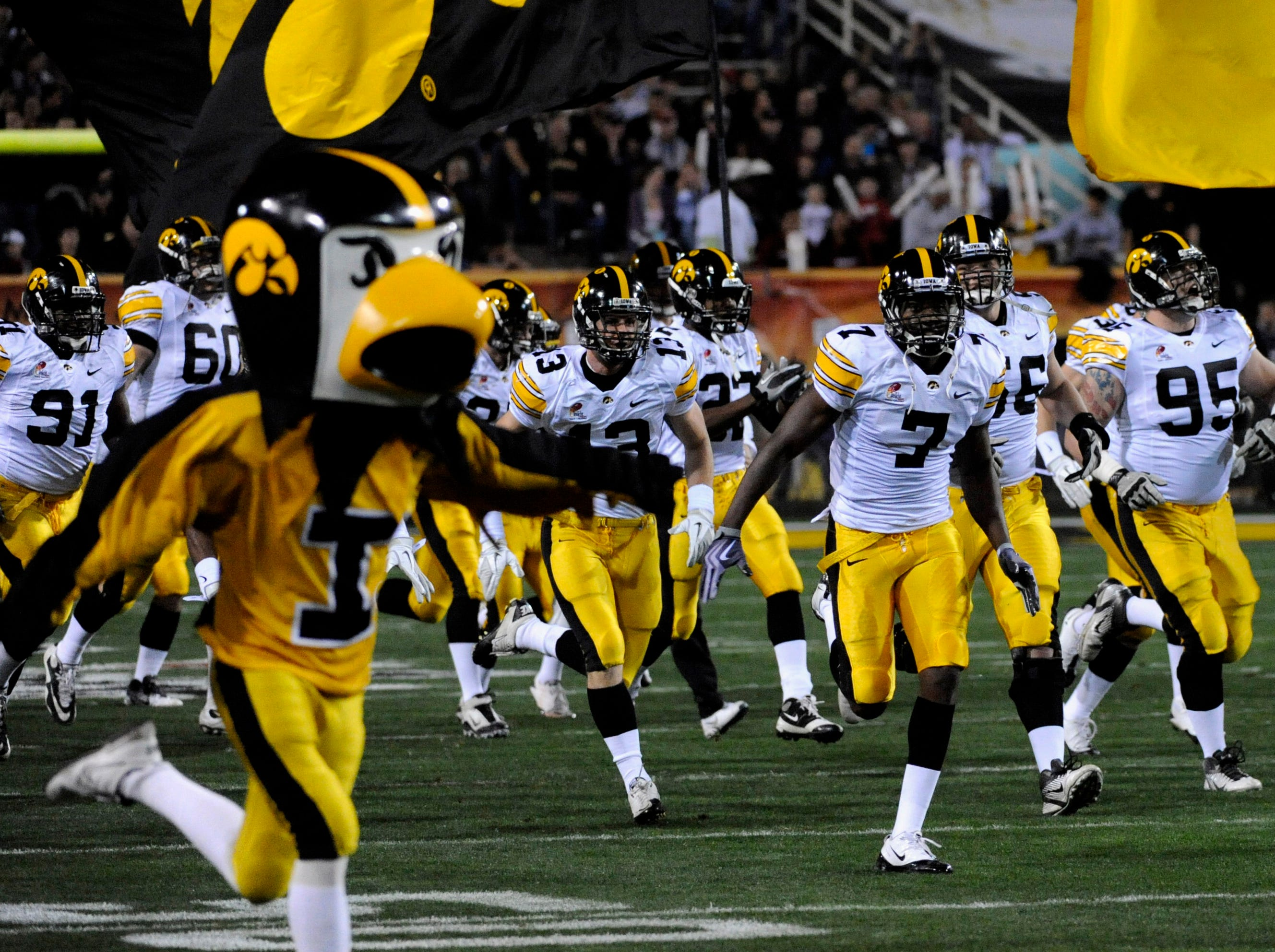Dec 30, 2011; Tempe, AZ, USA; Iowa Hawkeyes run onto the field before the first half of the 2011 Insight Bowl against the Oklahoma Sooners at the Sun Devil Stadium. Mandatory Credit: Richard Mackson-USA TODAY Sports