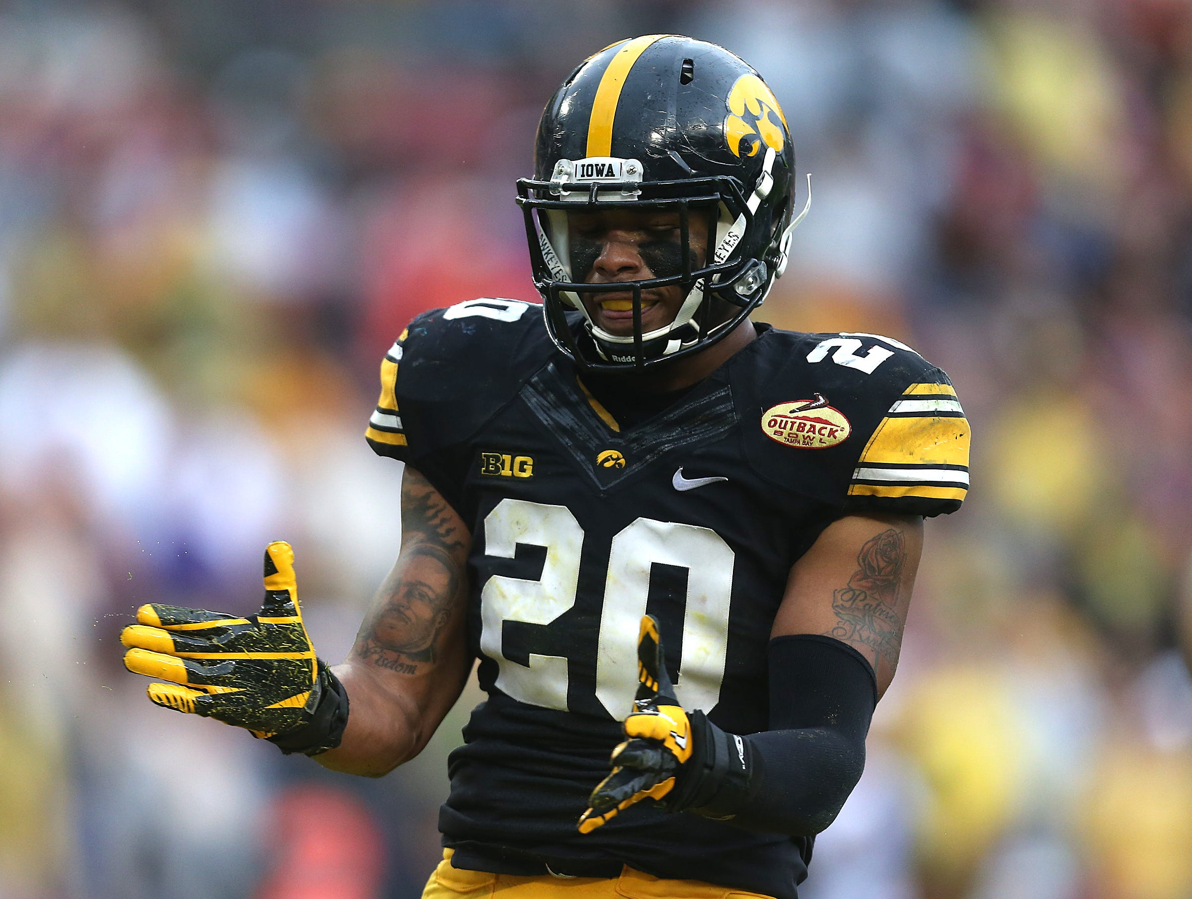 Iowa linebacker Christian Kirksey celebrates after a play against LSU in the Outback Bowl on Wednesday, Jan. 1, 2014, in Tampa, Florida. (Bryon Houlgrave/The Register)