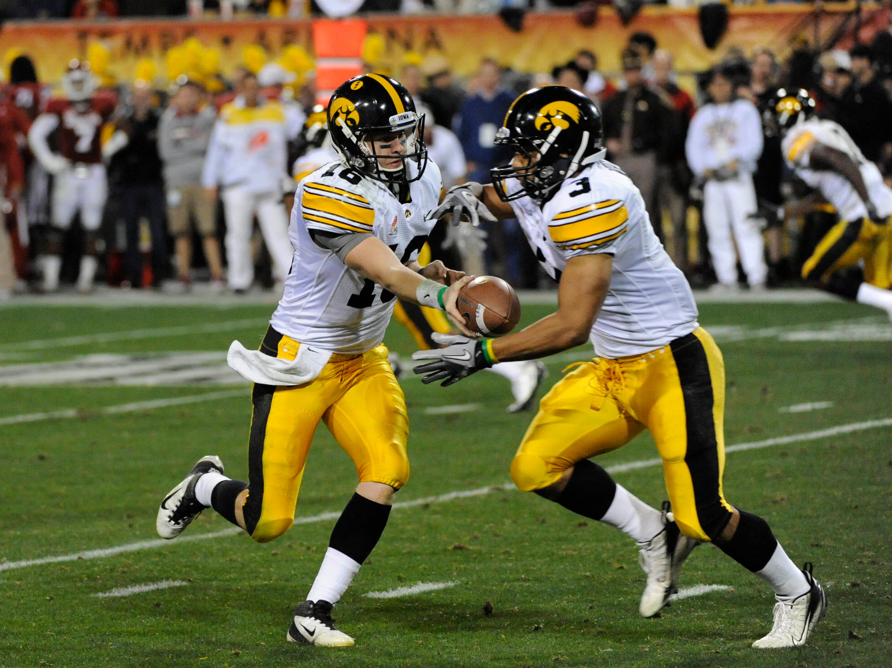 Dec 30, 2011; Tempe, AZ, USA; Iowa Hawkeyes quarterback James Vandenberg (16) hands the ball off to Iowa Hawkeyes running back Jason White (3) during the first half of the 2011 Insight Bowl at the Sun Devil Stadium. Mandatory Credit: Richard Mackson-USA TODAY Sports