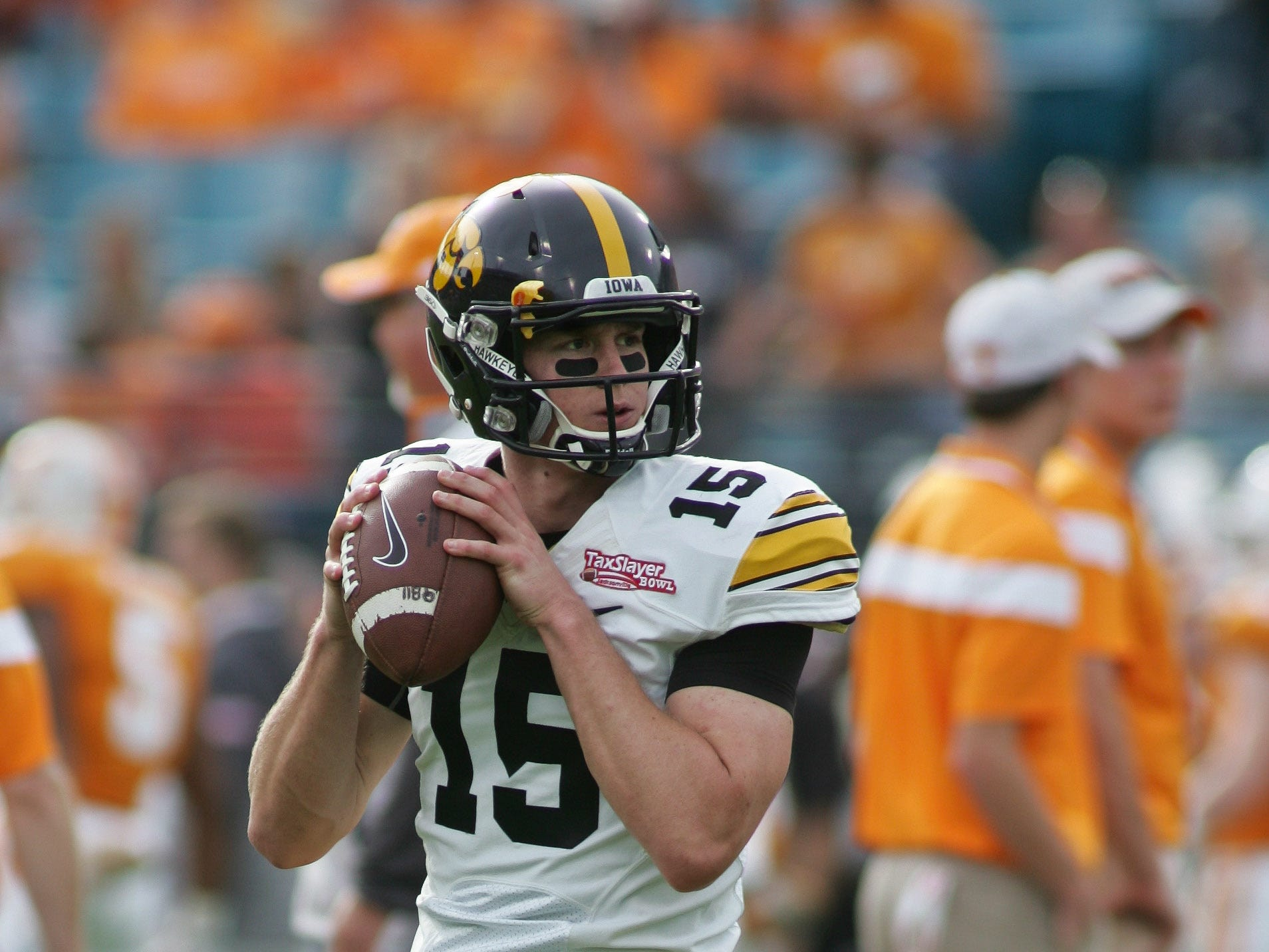 Jan 2, 2015; Jacksonville, FL, USA; Iowa Hawkeyes quarterback Jake Rudock (15) warms up before the start of the 2015 TaxSlayer Bowl against the Tennessee Volunteers at EverBank Field. The Tennessee Volunteers beat the Iowa Hawkeyes 45-28. Mandatory Credit: Phil Sears-USA TODAY Sports
