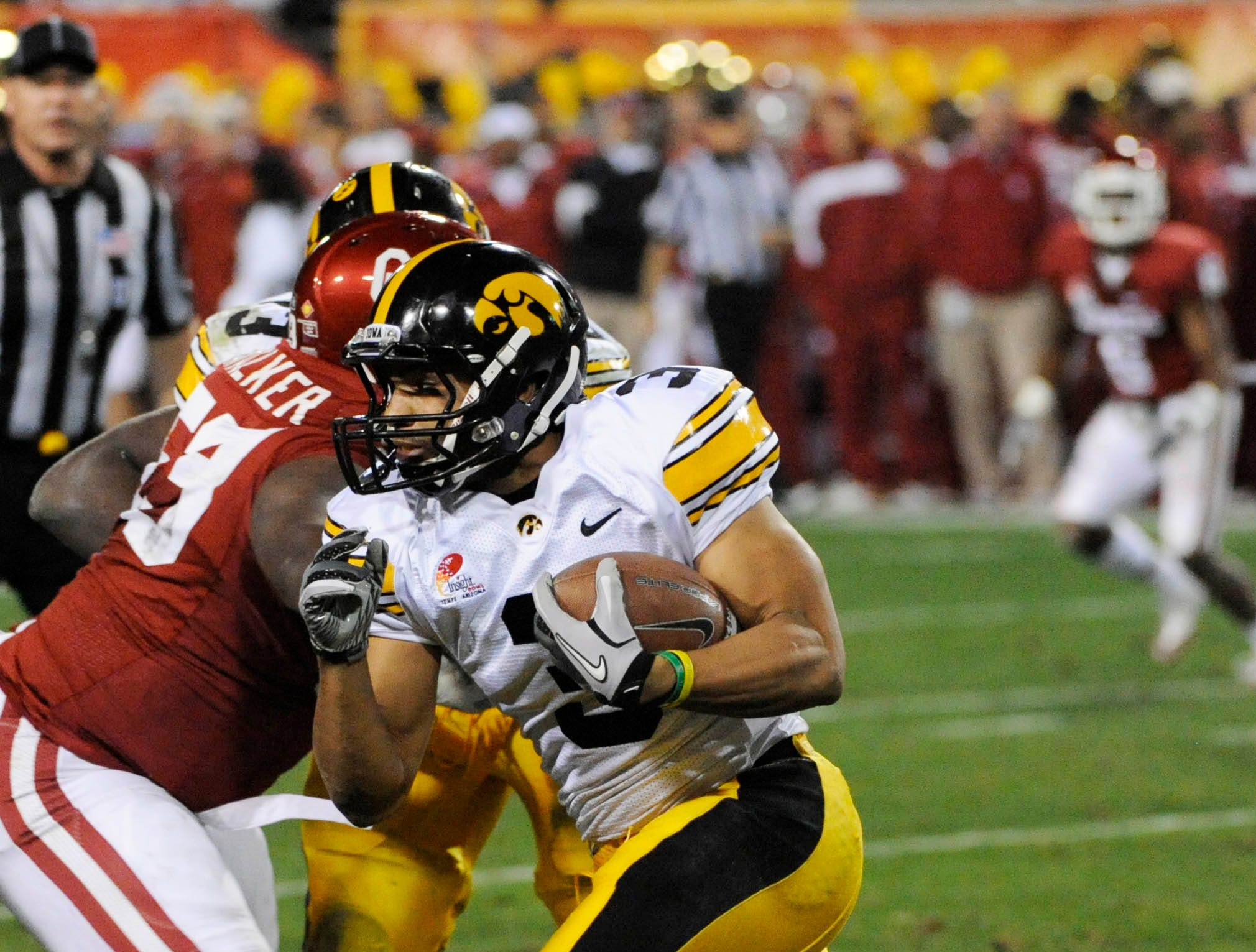 Dec 30, 2011; Tempe, AZ, USA; Iowa Hawkeyes running back Jason White (3) runs with the ball against Oklahoma Sooners during the first half of the 2011 Insight Bowl at the Sun Devil Stadium. Mandatory Credit: Richard Mackson-USA TODAY Sports