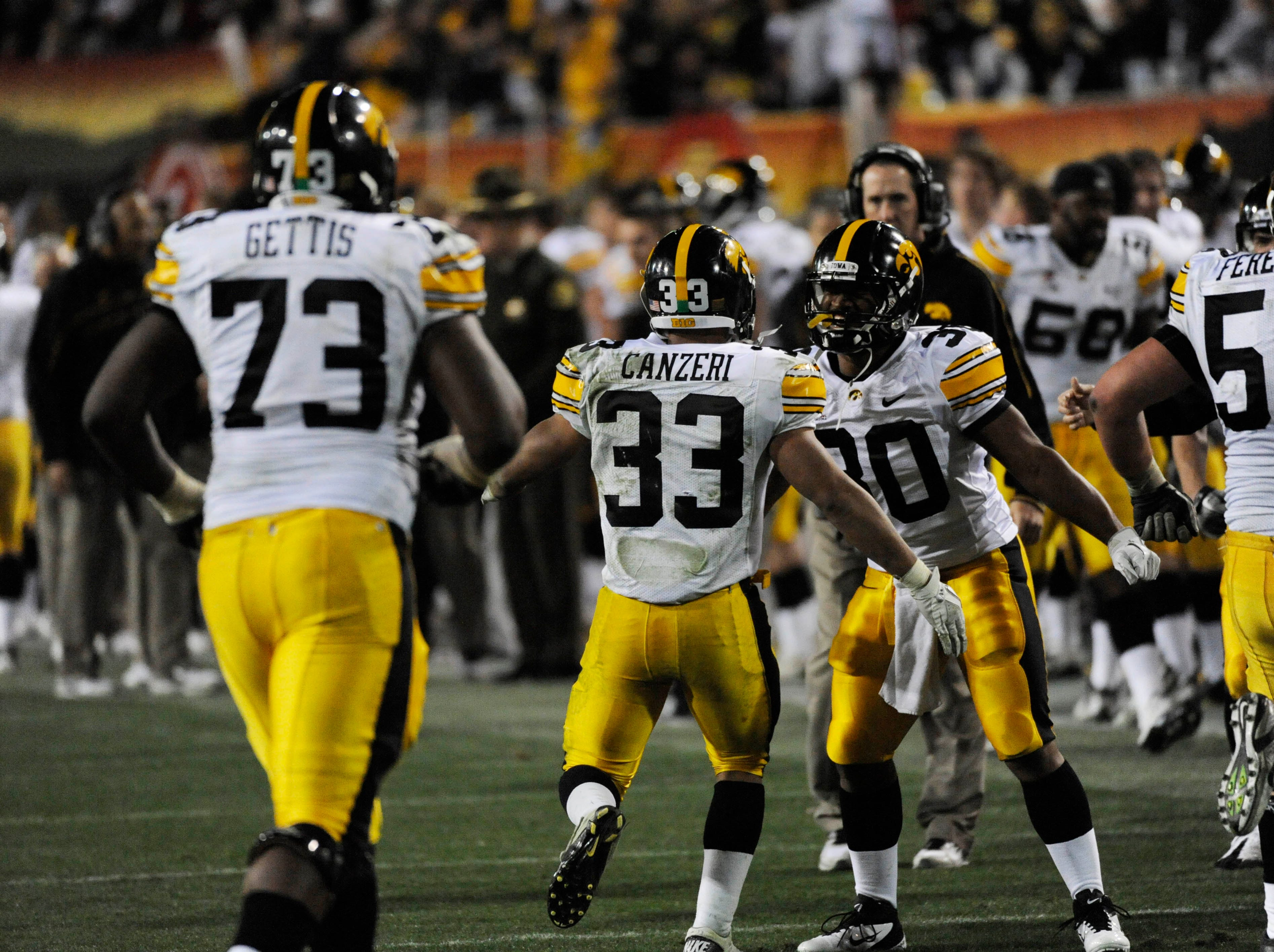 Dec 30, 2011; Tempe, AZ, USA; Iowa Hawkeyes running back Jordan Canzeri (33) and teammates celebrate his touchdown against Oklahoma Sooners during the second half of the 2011 Insight Bowl at the Sun Devil Stadium. Mandatory Credit: Richard Mackson-USA TODAY Sports