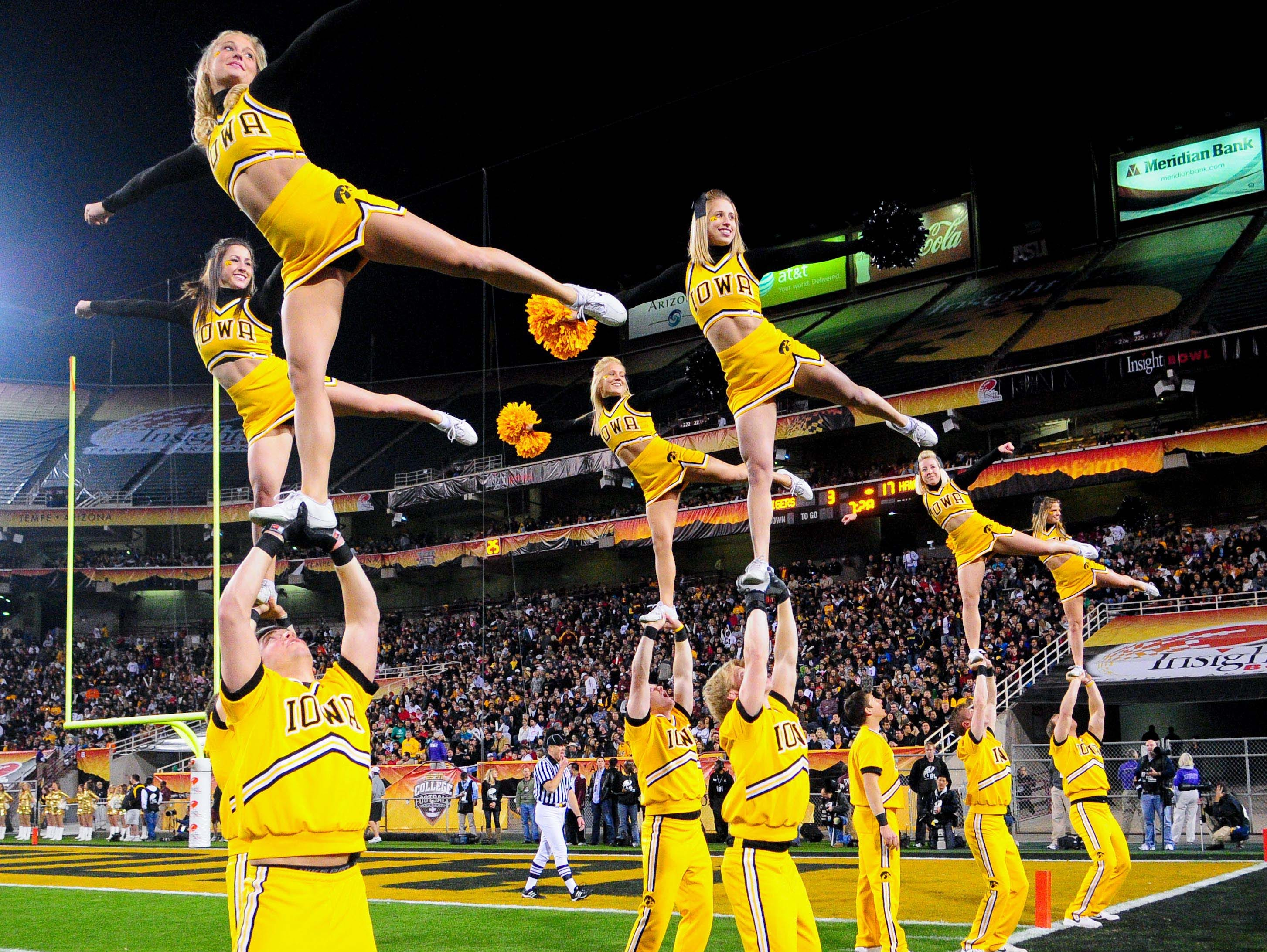 Dec. 28, 2010; Tempe, AZ, USA; Iowa Hawkeyes cheerleaders perform during the first half against the Missouri Tigers during the 2010 Insight Bowl at Sun Devil Stadium. The Hawkeyes beat the Tigers 27-24.  Mandatory Credit: Matt Kartozian-USA TODAY Sports