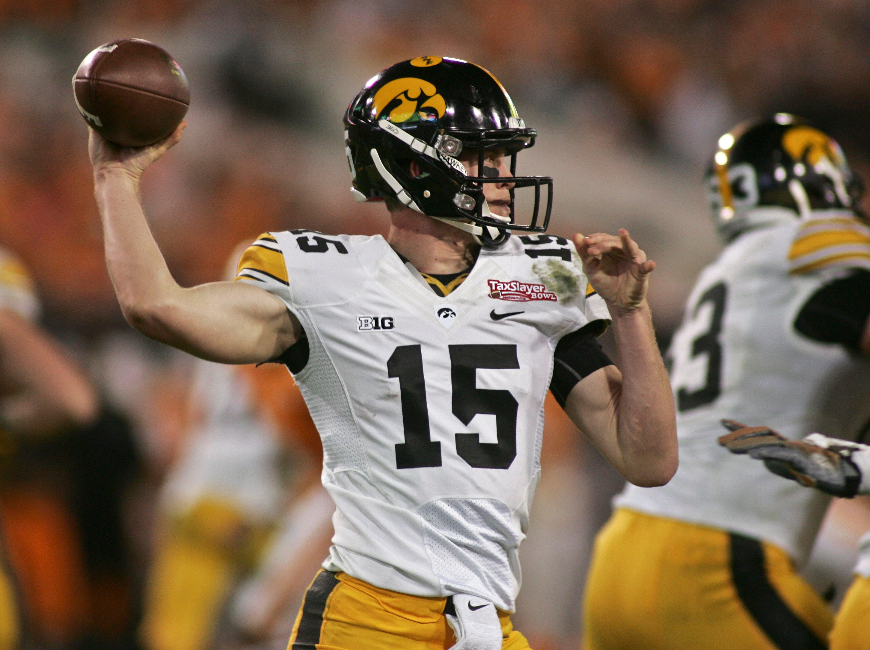 Jan 2, 2015; Jacksonville, FL, USA; Iowa Hawkeyes quarterback Jake Rudock (15) throws in the fourth quarter of their 2015 TaxSlayer Bowl game against the Tennessee Volunteersat EverBank Field. The Tennessee Volunteers beat the Iowa Hawkeyes 45-28. Mandatory Credit: Phil Sears-USA TODAY Sports