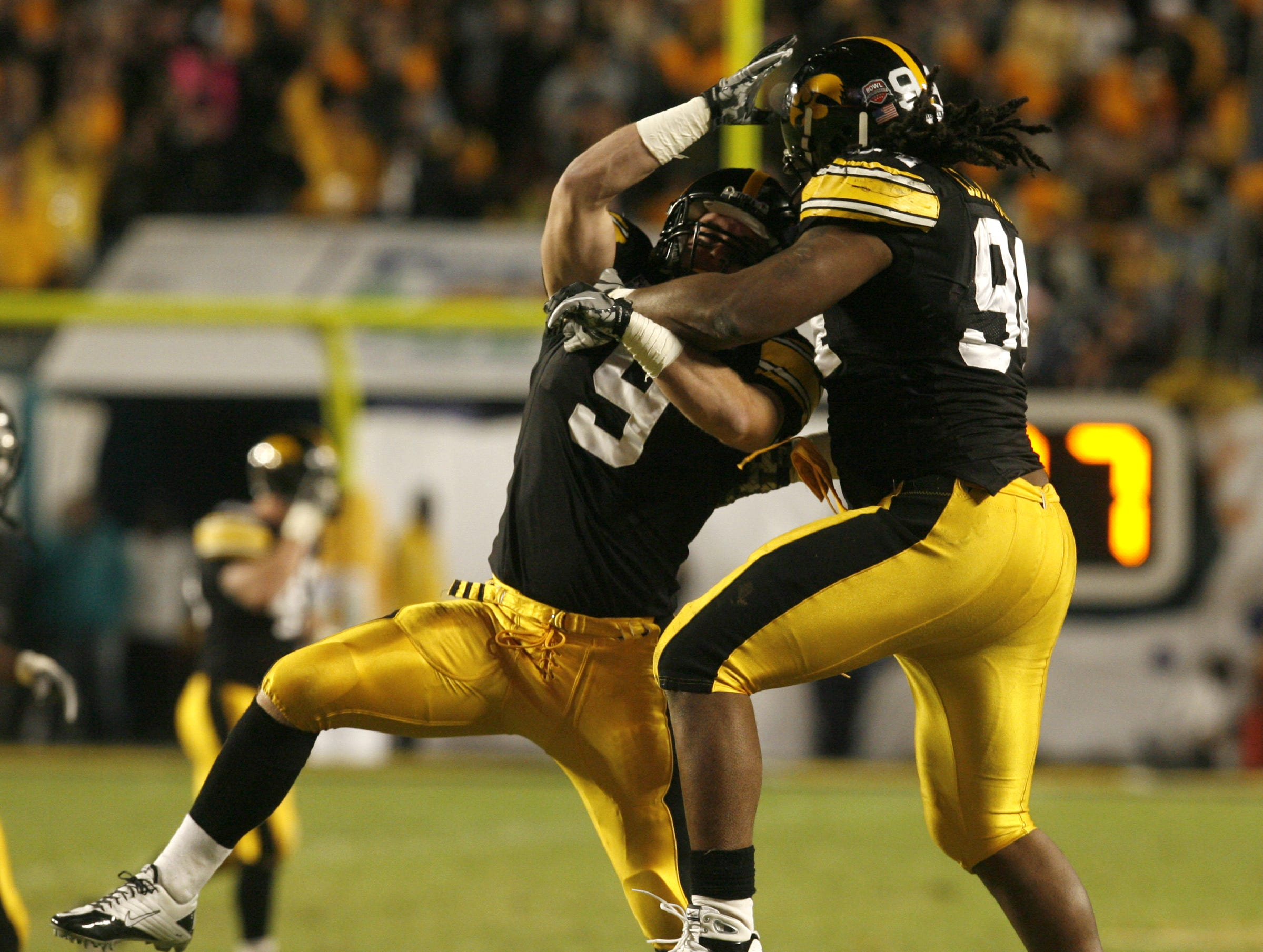 Iowa's Tyler Sash and Adrian Clayborn celebrate after stopping Georgia Tech, in the first quarter of the Orange Bowl, Tuesday, Jan. 5, 2010, at LandShark Stadium, in Miami Gardens, Fl.