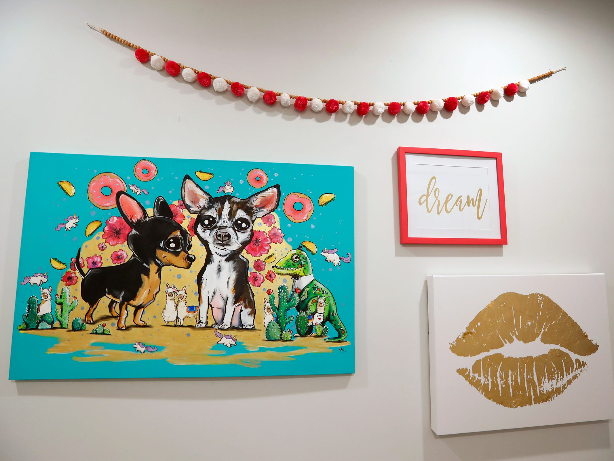 AirBnb owner Felicia Kiesel's dog, Chiquita (Chichi), left, and her mother's dog, Lucy, are portrayed in this personal painting by Amanda Keller, seen in the AirBnb at 804 N. Keystone Ave., Monday, Dec. 3, 2018.