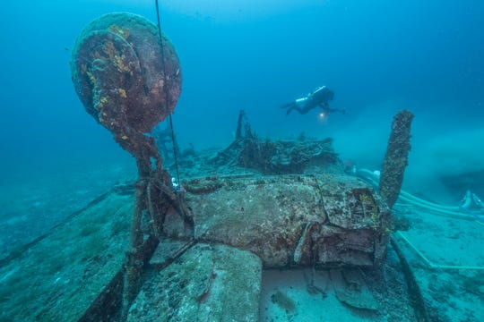 The Tulsamerican's one extended landing gear as a diver explores.
