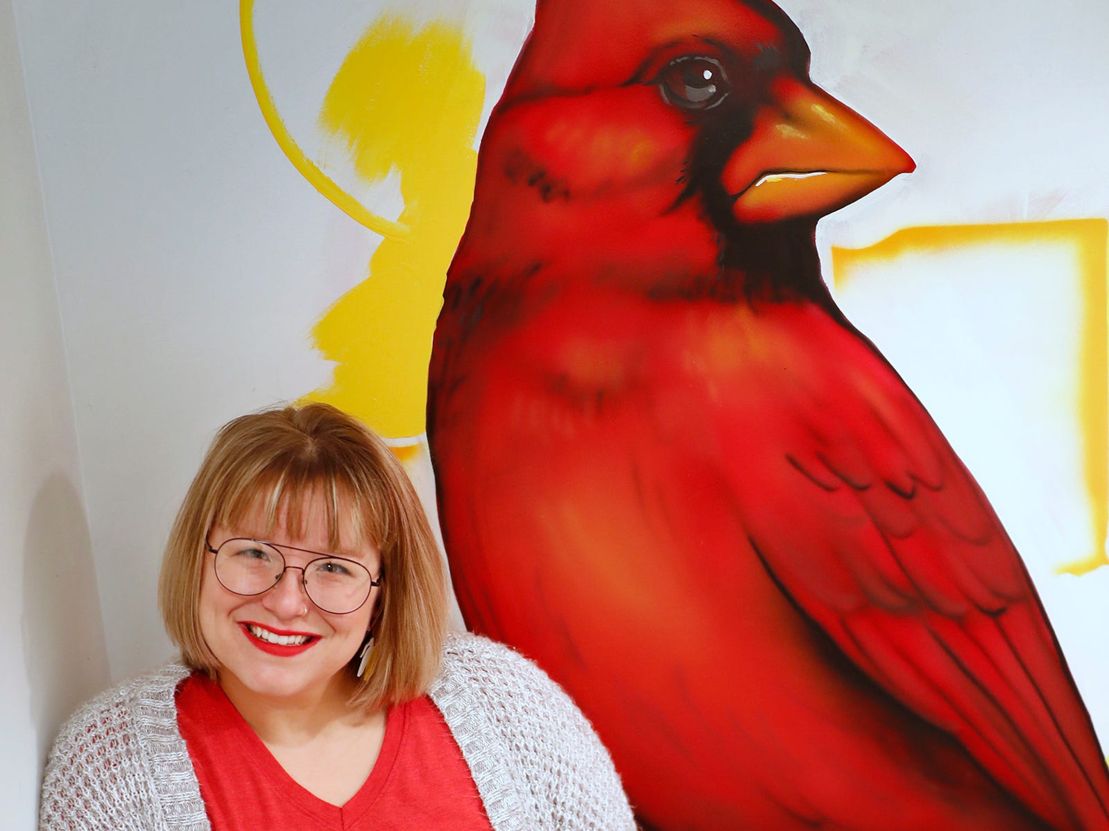 AirBnb owner Felicia Kiesel loves Indianapolis and uses items throughout the rental that remember the city, at 804 N. Keystone Ave., Monday, Dec. 3, 2018, including this mural with the state bird, right, the cardinal, and flower, the peony.
