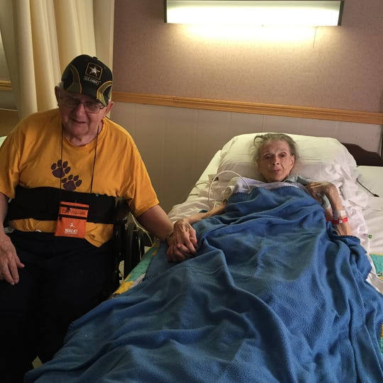 This is a photo of Curtis Willis, left, with his wife Hilda, when she spent her last days with him at Golden Living Center - Brookview.  Willis is a former boxer and double Purple Heart recipient from when he was a medic in the Korean War.