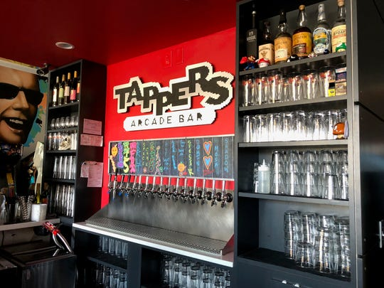 The bar inside Tappers Arcade shows off its curated beer menu and craft cocktails on tap.