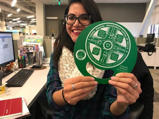 IndyStar reporter Natalia Contreras holds a roundabout guide she keeps at her desk for reference. The guides are available at Carmel City Hall or online.