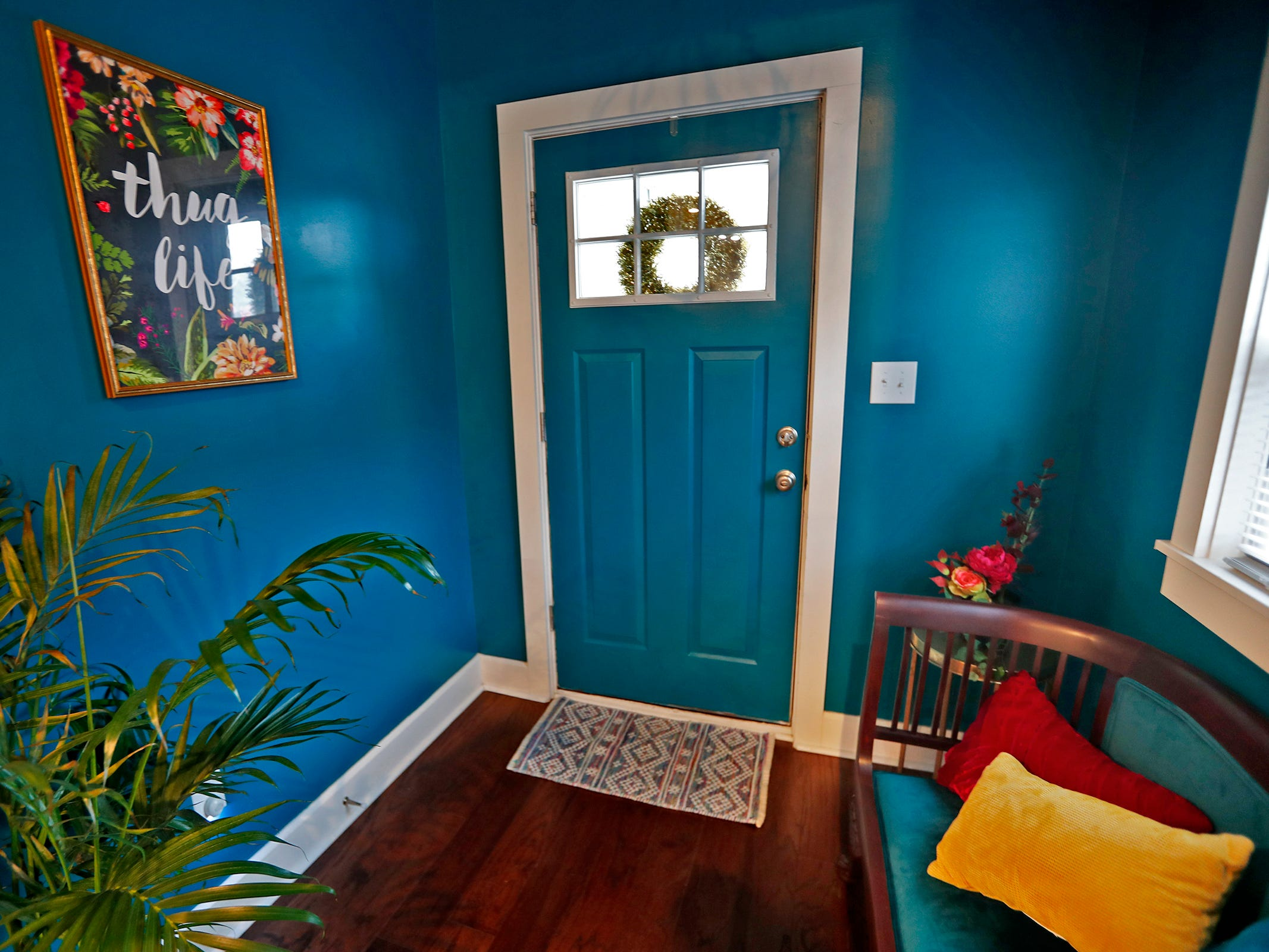 The front entryway is full of color, as seen in an AirBnb at 804 N. Keystone Ave., Monday, Dec. 3, 2018.
