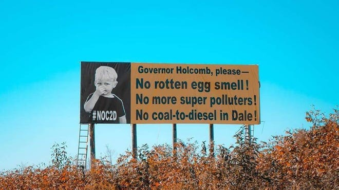 A billboard had been added along Interstate 64 in Spencer County in Indiana in opposition to a proposed plant that would turn coal into diesel fuel.