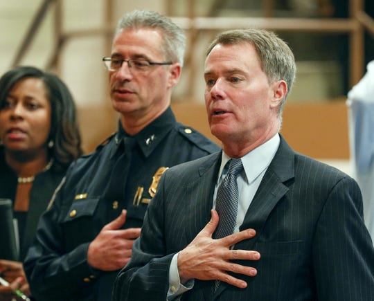 Indianapolis Mayor Joe Hogsett (right) and IMPD Chief Bryan Roach attend a swearing-in ceremony for the 16th recruit class.