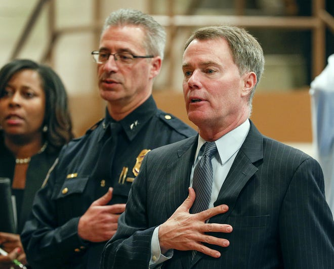Indianapolis Mayor Joe Hogsett and IMPD Chief of Police Bryan Roach during the swearing-in ceremony for the 16th recruit class. Fifty nine new recruits joined the Indianapolis Metropolitan Police Department during swearing-in ceremony for the 16th sworn recruit class at the Public Safety Training Academy Tuesday, December 18, 2017.