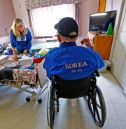 Curtis Willis, right, talks with his daughter Kathy Rinks, at Golden Living Center - Brookview, Friday, Nov. 30, 2018.  Willis is a former boxer and double Purple Heart recipient from when he was a medic in the Korean War.