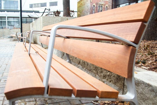 New benches with a hand rail midway through the seat are seen on Tuesday, Dec. 4, 2018, on the Pedestrian Mall in downtown Iowa City.