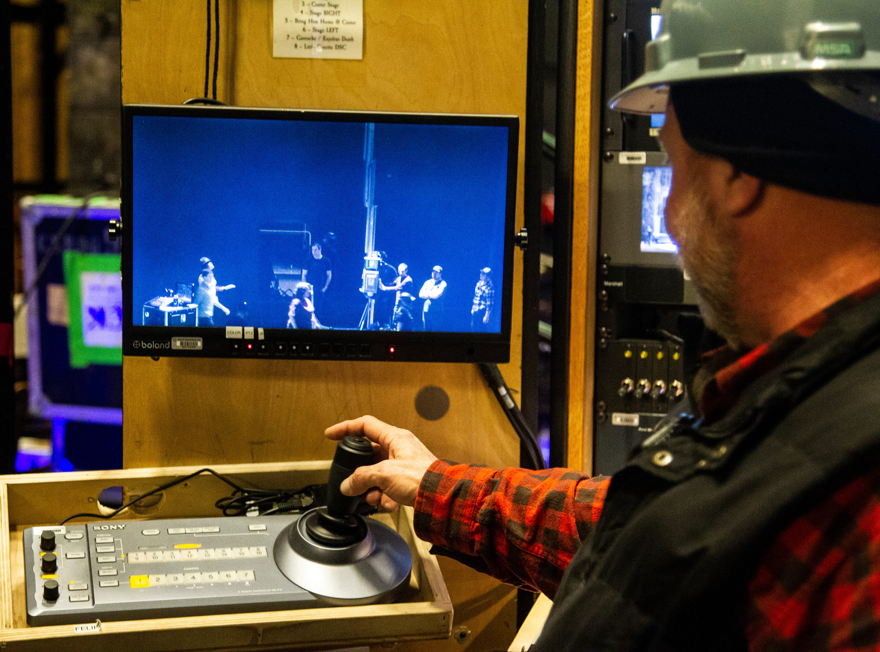 Jack McLeod, production stage manager, demonstrates with a remote camera used during the production of Les Misérables while crew set up before its opening show on Tuesday, Dec. 4, 2018, at Hancher Auditorium on the University of Iowa campus in Iowa City.