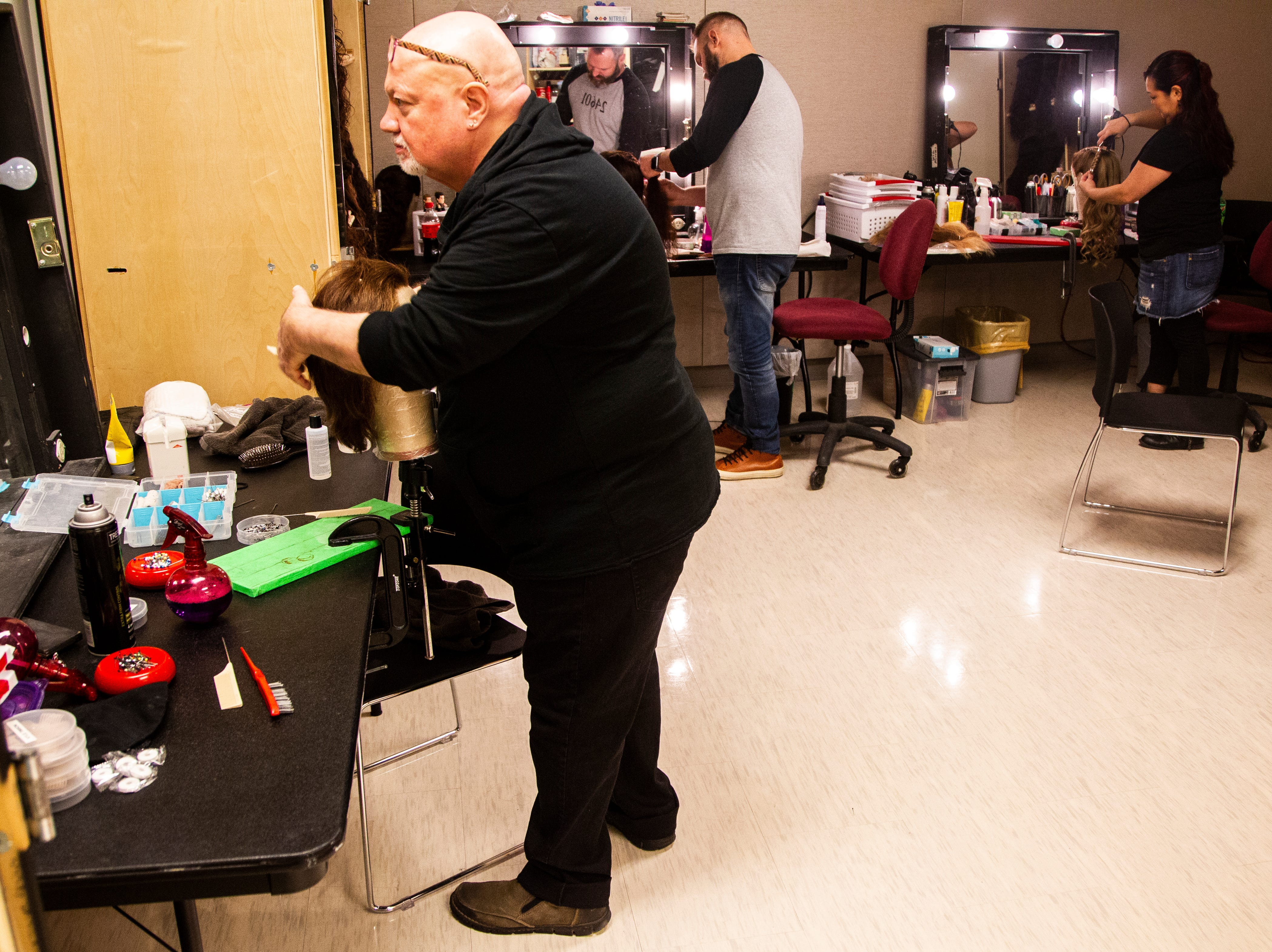 Members of the Les Misérables crew work on washing and styling wigs before its opening show on Tuesday, Dec. 4, 2018, at Hancher Auditorium on the University of Iowa campus in Iowa City.